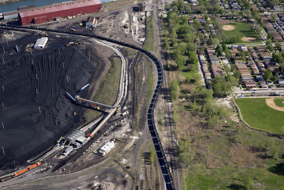 For years, piles of petcoke stored along the Calumet River resulted in thick clouds of black dust blowing through Southeast Side neighborhoods. (Terry Evans / Courtesy of Museum of Contemporary Photography)