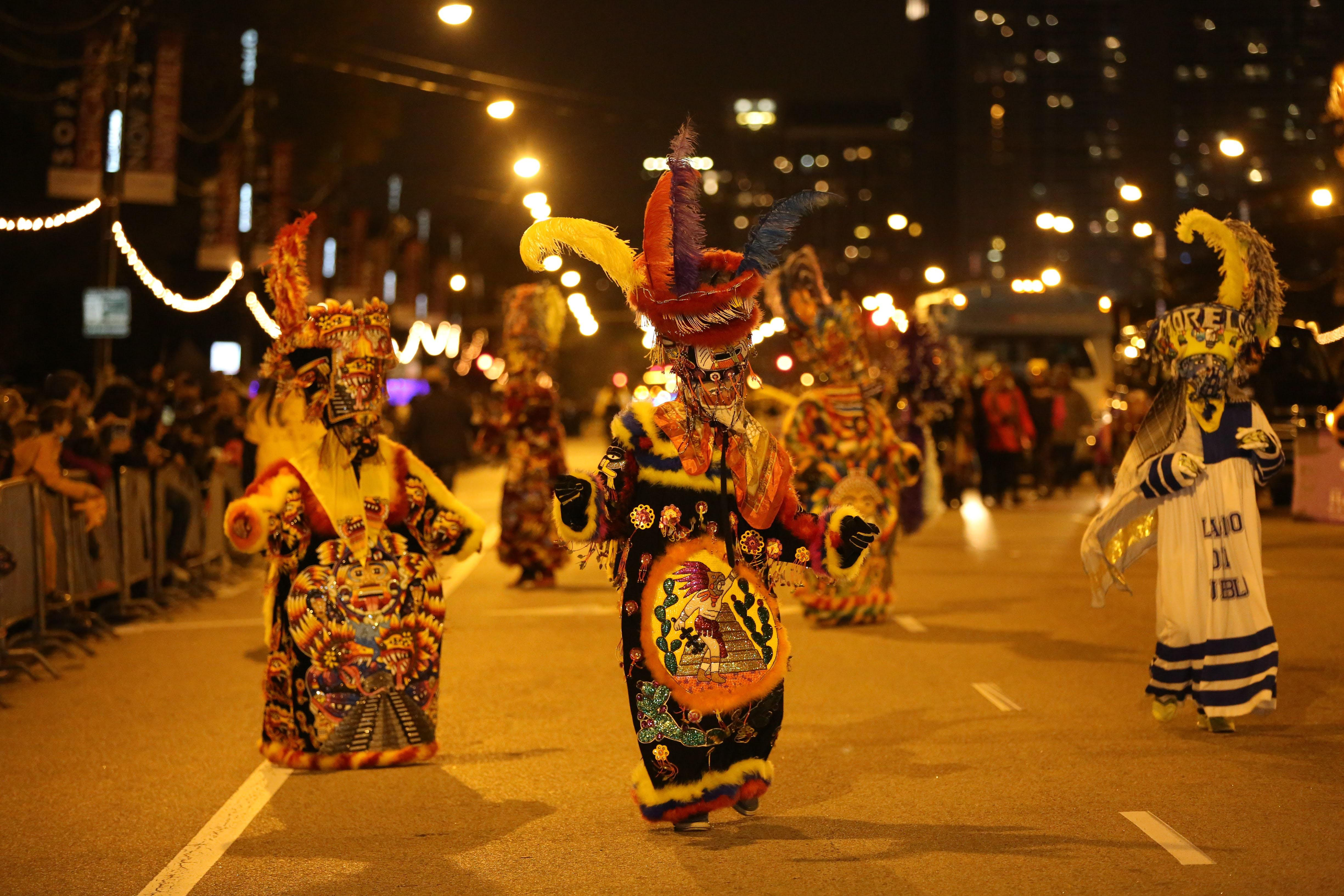 Spectacle after sundown: Don't miss the Arts in the Dark parade Saturday.