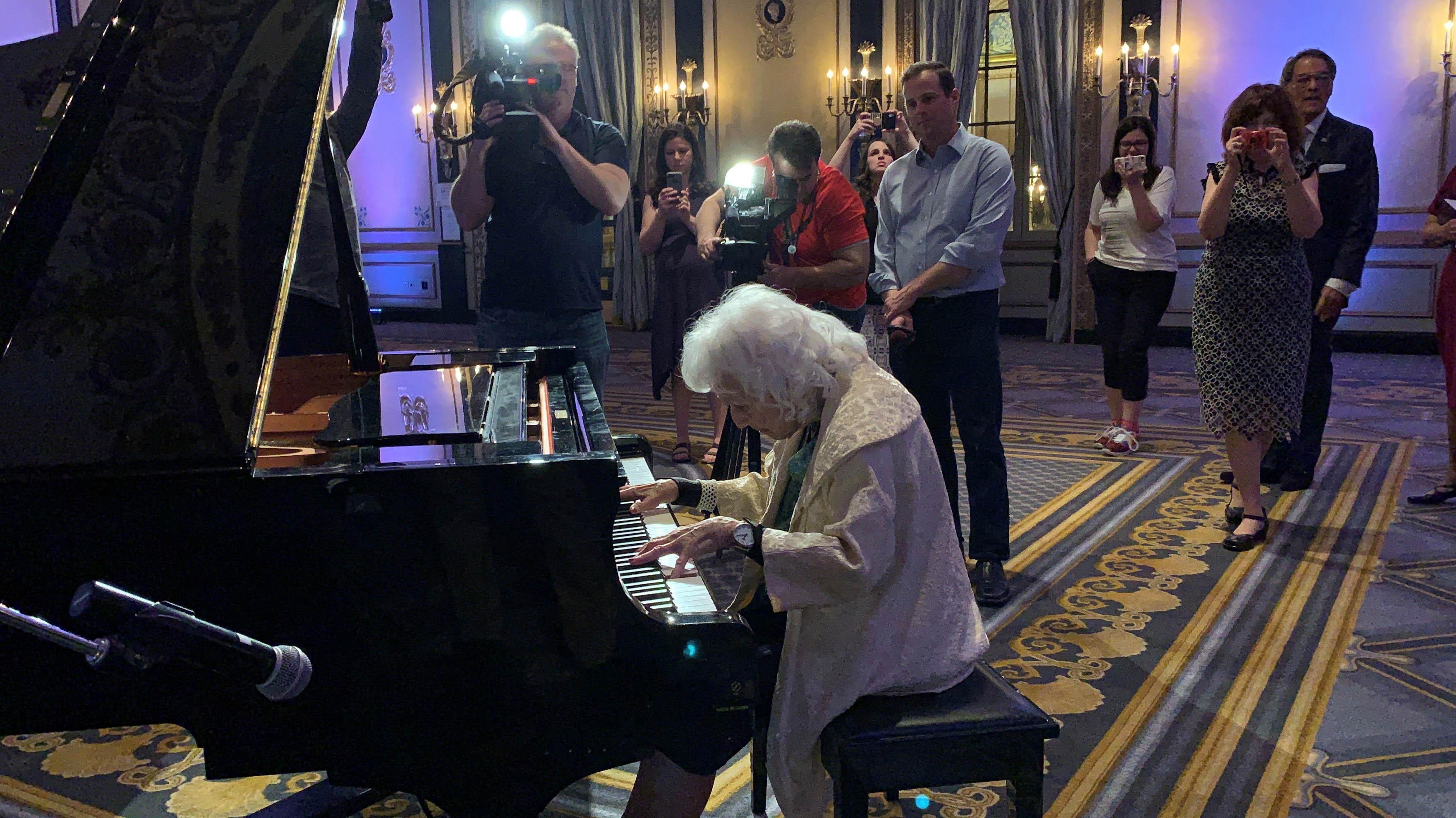 Dorothy Olson Pauletti, back at the piano in the Empire Room.