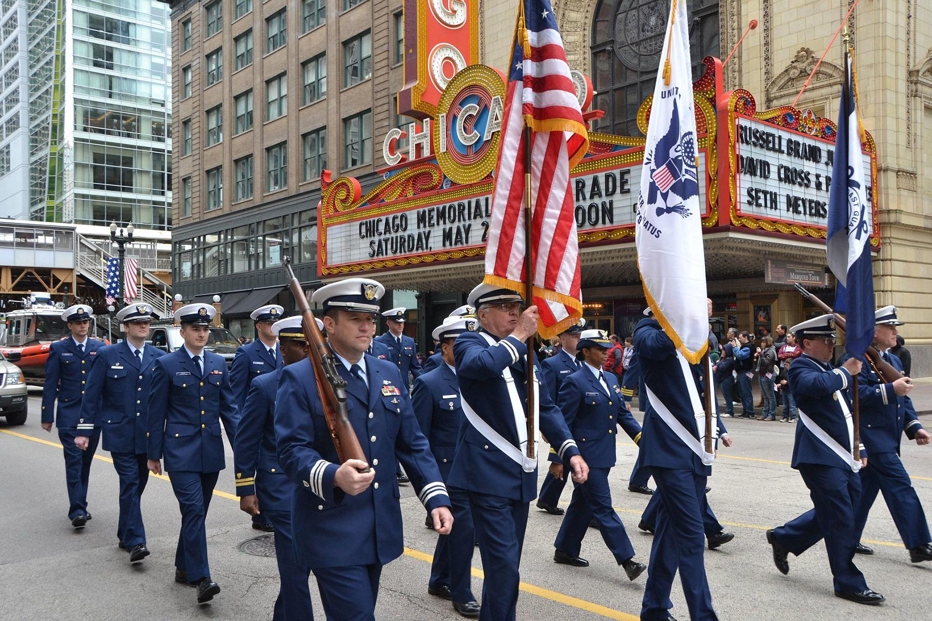 Members of the Coast Guard and Coast Guard Auxiliary march along State Street during the Chicago Memorial Day Parade on May 25, 2013. (Coast Guard News / Flickr)