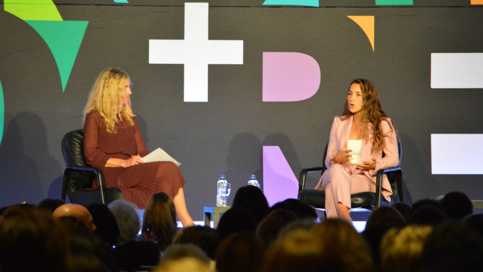 Olympic gymnast Aly Raisman, right, speaks with Chicago Tribune columnist Heidi Stevens on Tuesday, Sept. 18, 2018 during the Chicago Foundation for Women's 33rd annual symposium. (Kristen Thometz / Chicago Tonight)