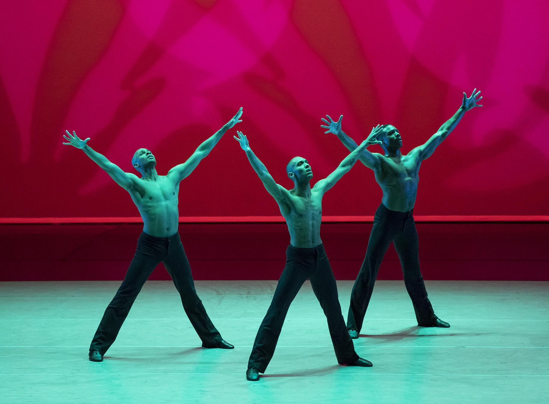 "Alvin Ailey American Dance Theater's Yannick Lebrun, Sean Aaron Carmon and Michael Jackson Jr. in ""Revelations."" (Photo by Paul Kolnik)"