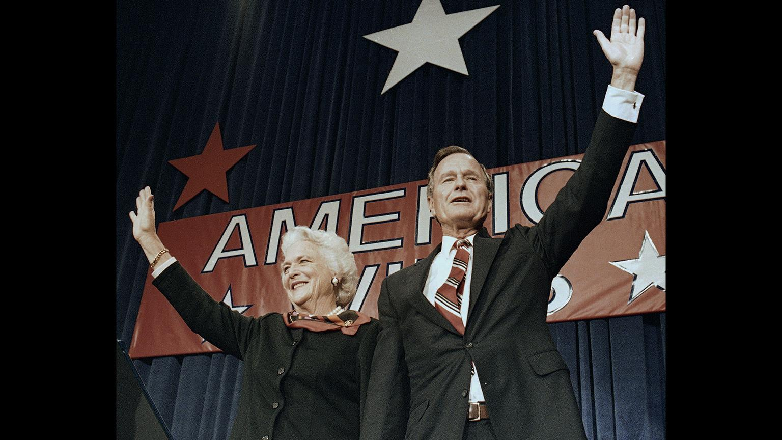 In this Nov. 8, 1988 file photo, President-elect George H.W. Bush and his wife Barbara wave to supporters in Houston, Texas after winning the presidential election. (AP Photo / Scott Applewhite, File)