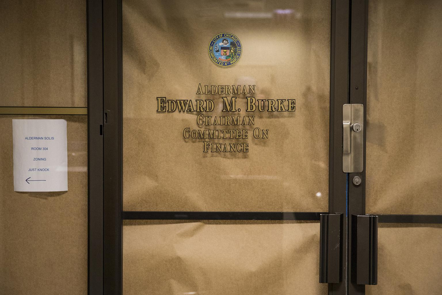 Brown paper covers the windows of Ald. Edward Burke's office at Chicago City Hall on Thursday morning, Nov. 29, 2018. (Ashlee Rezin / Chicago Sun-Times via AP)