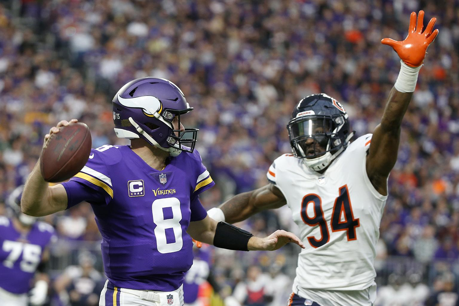 5bf7eda6676 Minnesota Vikings quarterback Kirk Cousins (8) looks to throw a pass over  Chicago Bears