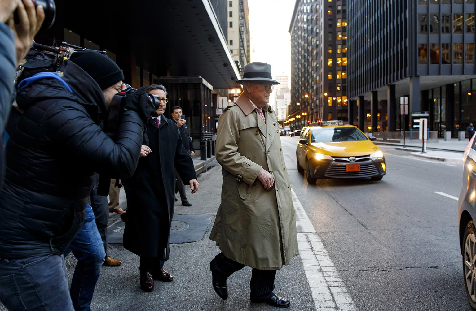 Ald. Ed Burke, 75, walks out of the Dirksen Federal Courthouse following his release after turning himself in on Thursday, Jan. 3, 2019. (Brian Cassella / Chicago Tribune via AP)