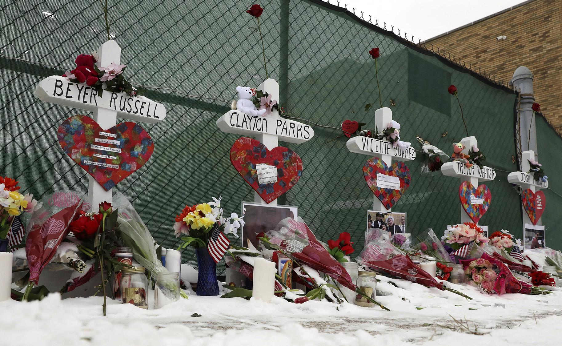 Crosses are placed for the victims of a mass shooting Sunday, Feb. 17, 2019, in Aurora, near Henry Pratt Co. manufacturing company where several were killed on Friday. (AP Photo / Nam Y. Huh)