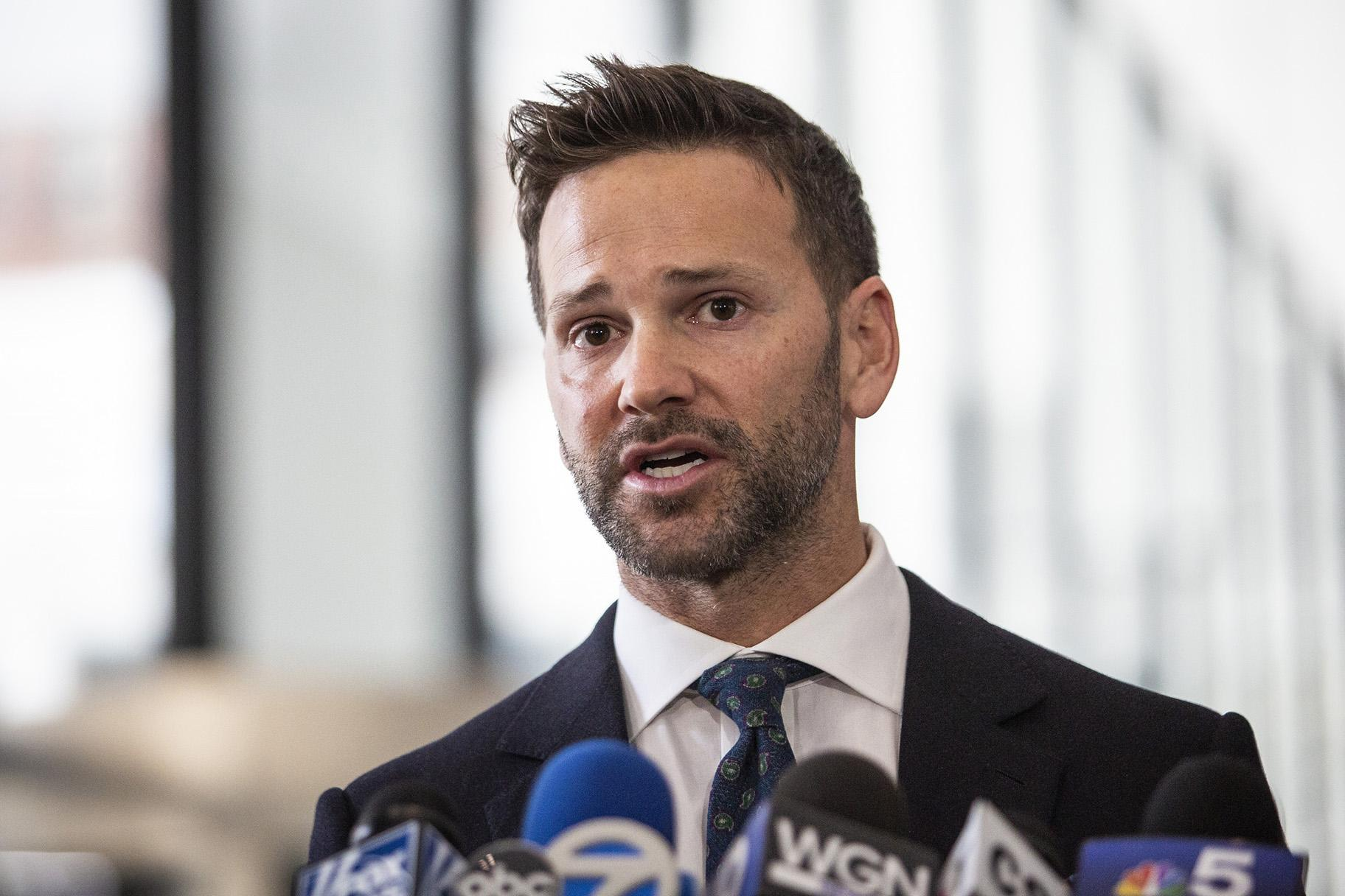 Former U.S. Rep. Aaron Schock speaks to reporters at the Dirksen Federal Courthouse on Wednesday, March 6, 2019. (Ashlee Rezin / Chicago Sun-Times via AP)