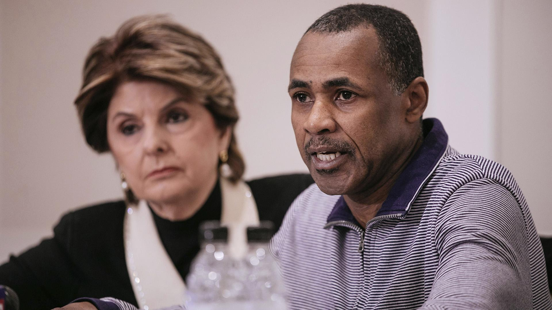 Gary Dennis, seated with lawyer Gloria Allred, speaks during a Sunday, March 10, 2019 press conference announcing a videotape said to present further evidence of wrongdoing by recording artist R. Kelly. Dennis said the tape, which he found at his home in Pennsylvania, shows R. Kelly sexually abusing more than one underage girl. (AP Photo / Kevin Hagen)