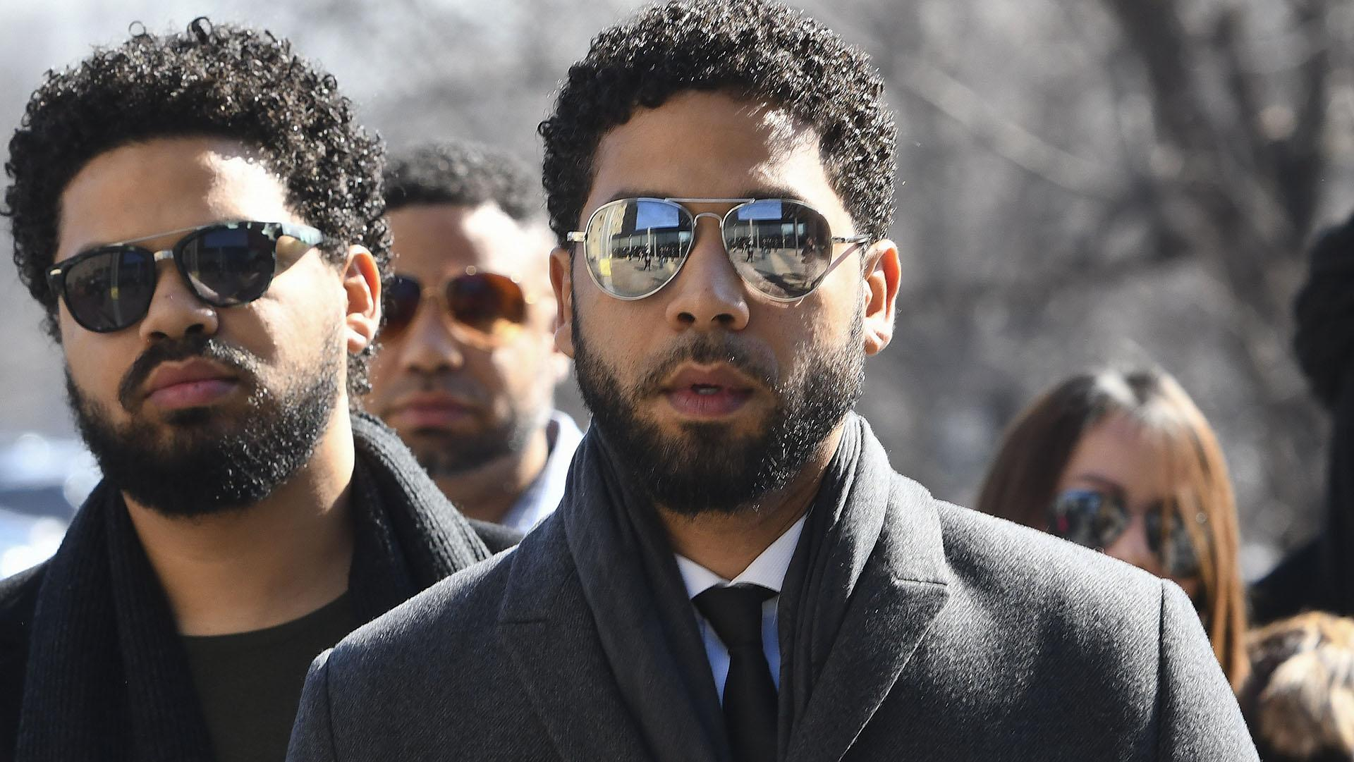 """Empire"" actor Jussie Smollett, center, arrives at Leighton Criminal Court Building for a hearing to discuss whether cameras will be allowed in the courtroom during his disorderly conduct case on Tuesday, March 12, 2019, in Chicago. (AP Photo / Matt Marton)"