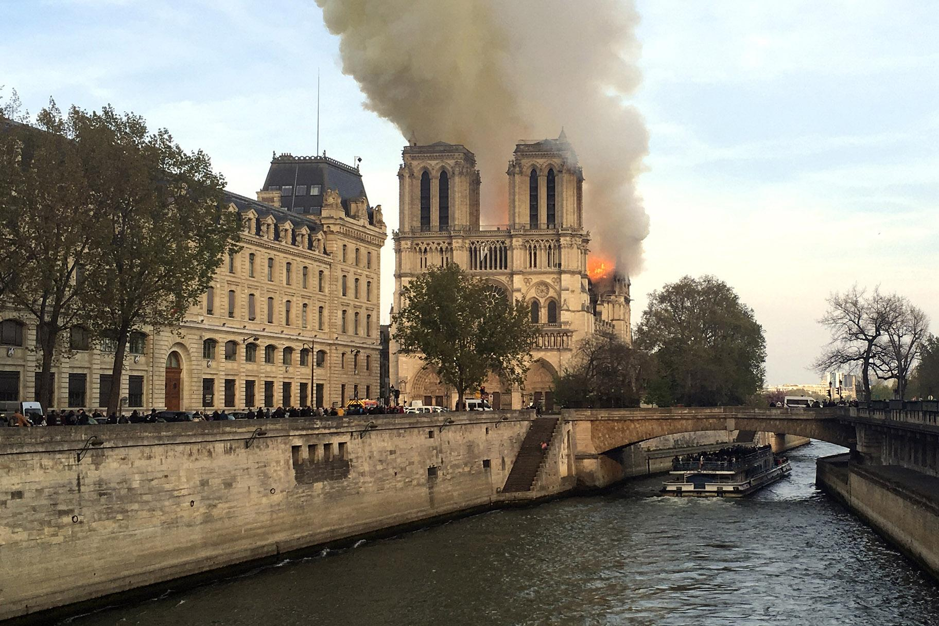 Notre Dame Cathedral is burning in Paris on Monday, April 15, 2019. (AP Photo / Lori Hinant)