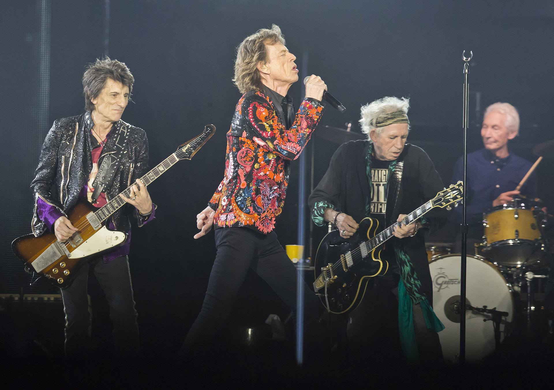 "In this Oct. 22, 2017, file photo from left, Ronnie Wood, Mick Jagger, Keith Richards and Charlie Watts of the Rolling Stones perform during the concert of their ""No Filter"" Europe Tour 2017 at U Arena in Nanterre, outside Paris. (AP Photo / Michel Euler, File)"