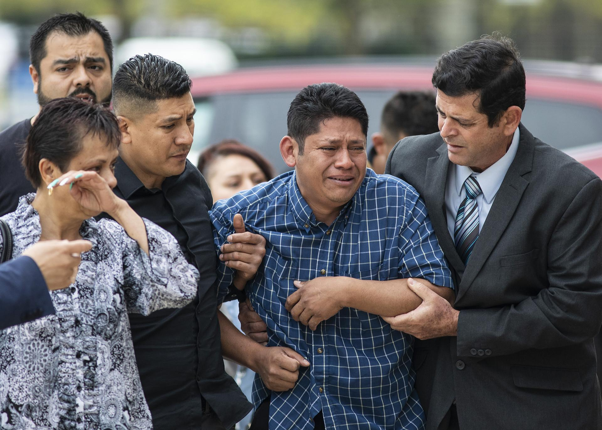 Arnulfo Ochoa, the father of Marlen Ochoa-Lopez, is surrounded by family members and supporters, as he walks into the Cook County medical examiner's office to identify his daughter's body, Thursday, May 16, 2019 in Chicago. (Ashlee Rezin / Chicago Sun-Times via AP)