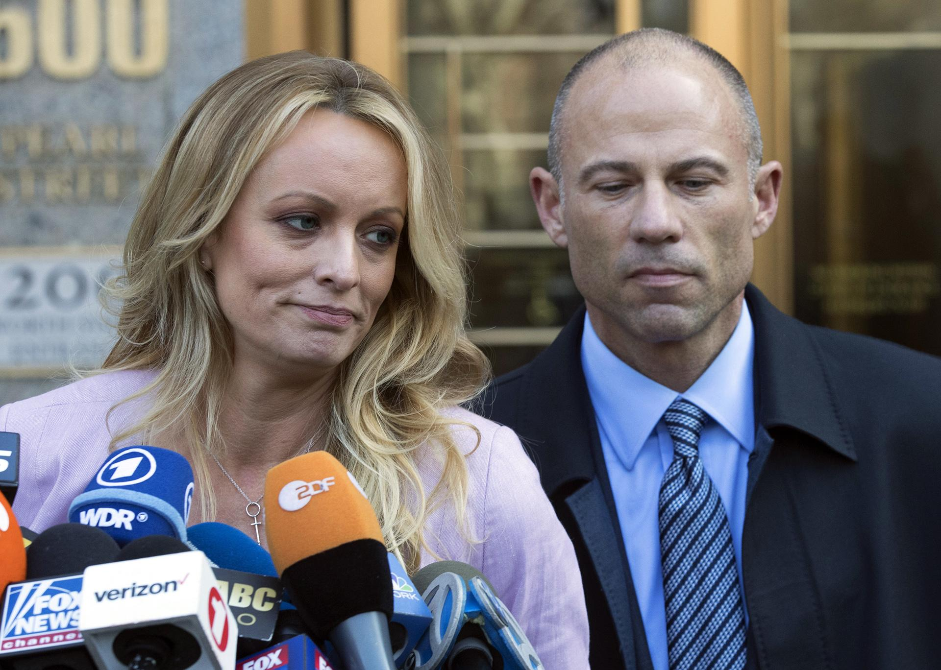 In this April 16, 2018 file photo, adult film actress Stormy Daniels, left, stands with her lawyer Michael Avenatti as she speaks outside federal court, in New York. (AP Photo / Mary Altaffer, File)