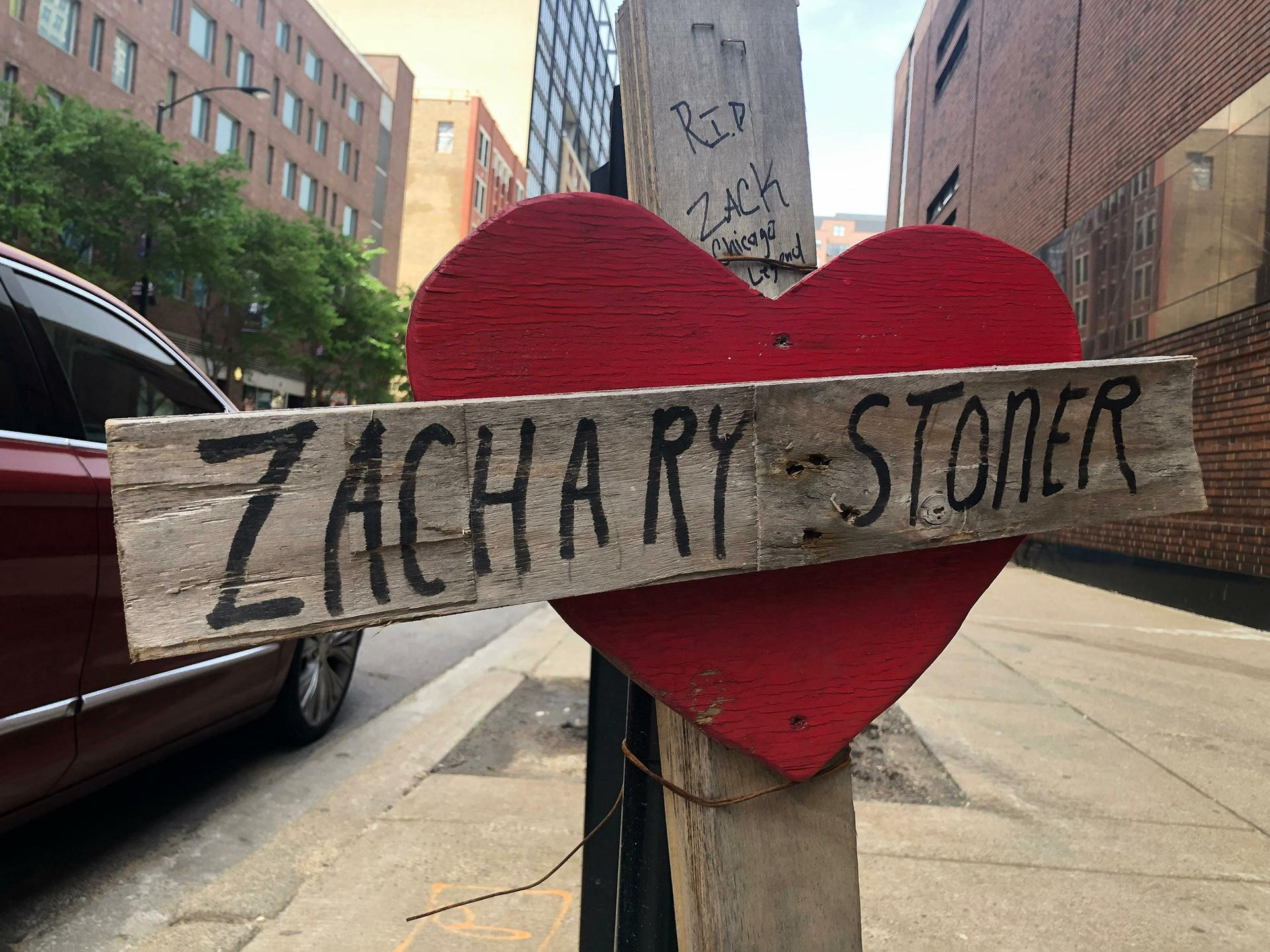 In this May 22, 2019 photo, a makeshift cross marking the spot where Zachary Stoner was killed on May 30, 2018, in a drive-by shooting in downtown Chicago. (AP Photo / Michael Tarm)