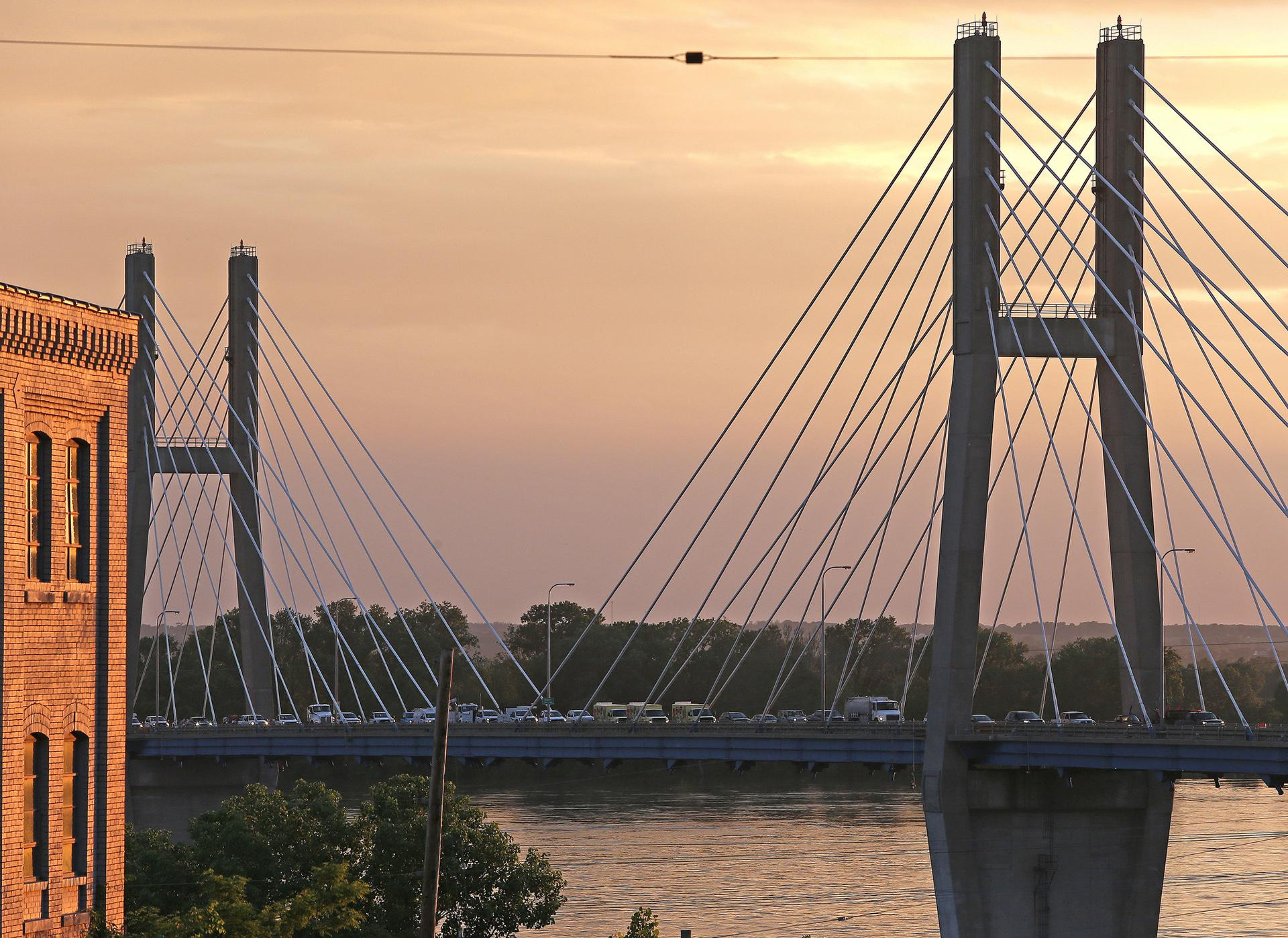 Traffic gets backed up on the Bayview Bridge as vehicles are rerouted in Quincy, Illinois on Thursday, May 30, 2019, after it was closed due to rising Mississippi River waters. The bridge connects Illinois to Missouri via U.S. Route 24. (Jake Shane / Quincy Herald-Whig via AP)