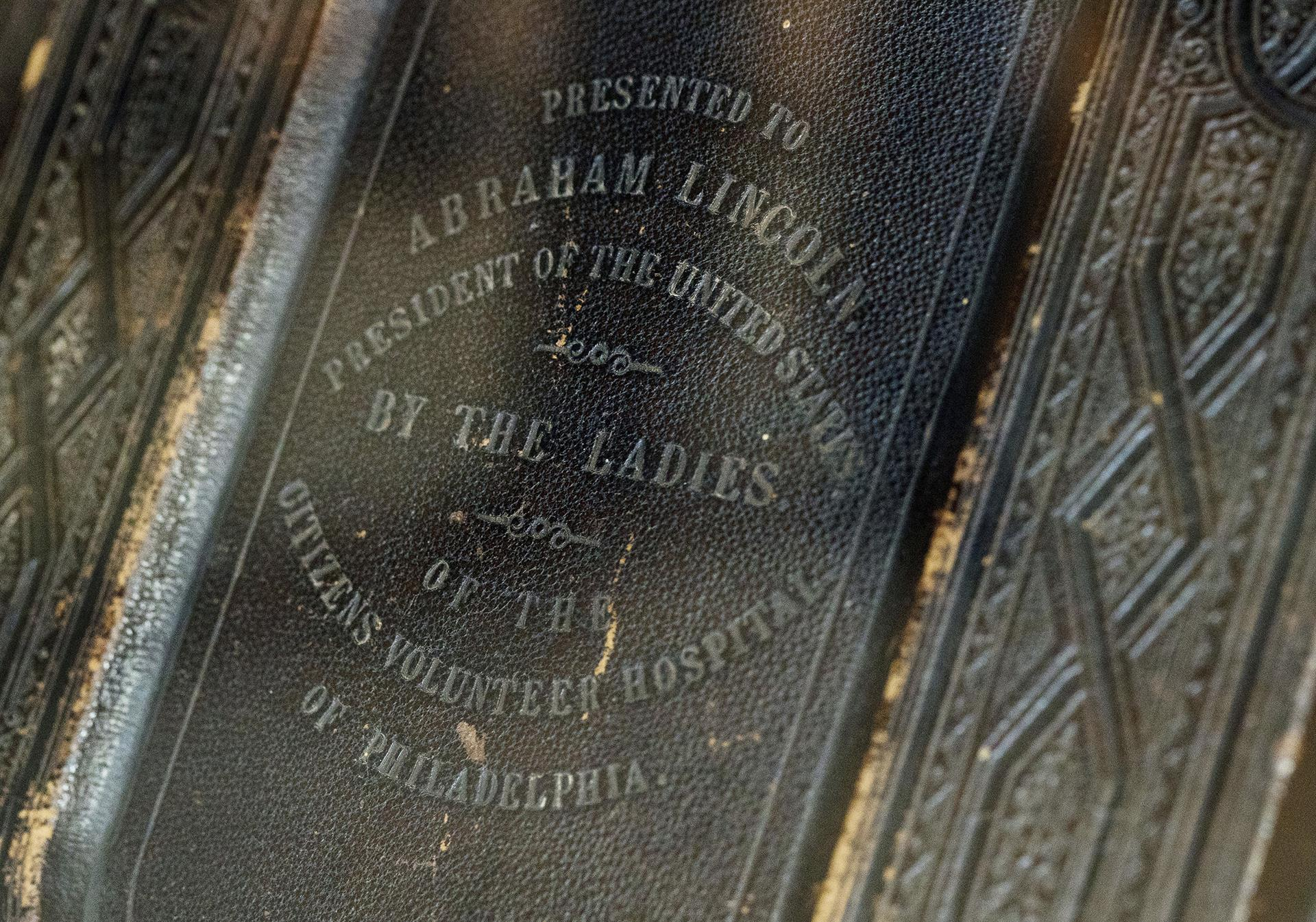 A King James version of the Bible, likely given to Abraham Lincoln in June 1864, that was later passed on by widow Mary Lincoln to her beloved Springfield neighbor Noyes W. Miner, a Baptist minister, is displayed at the Abraham Lincoln Presidential Library and Museum, where executive director Alan Lowe unveiled it, Thursday, June 20, 2019, in Springfield, Illinois. (Ted Schurter / The State Journal-Register via AP)