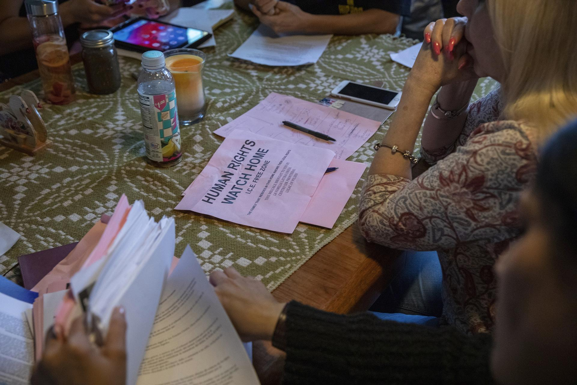 "In this Wednesday, June 19, 2019 photo, a flyer that reads ""Human Rights Watch Home, ICE Free Zone "" rests on a table during an emergency meeting plan of action on how to defend and protect undocumented communities of deportation at Lincoln Methodist Church in Chicago's Pilsen neighborhood. (AP Photo / Amr Alfiky)"