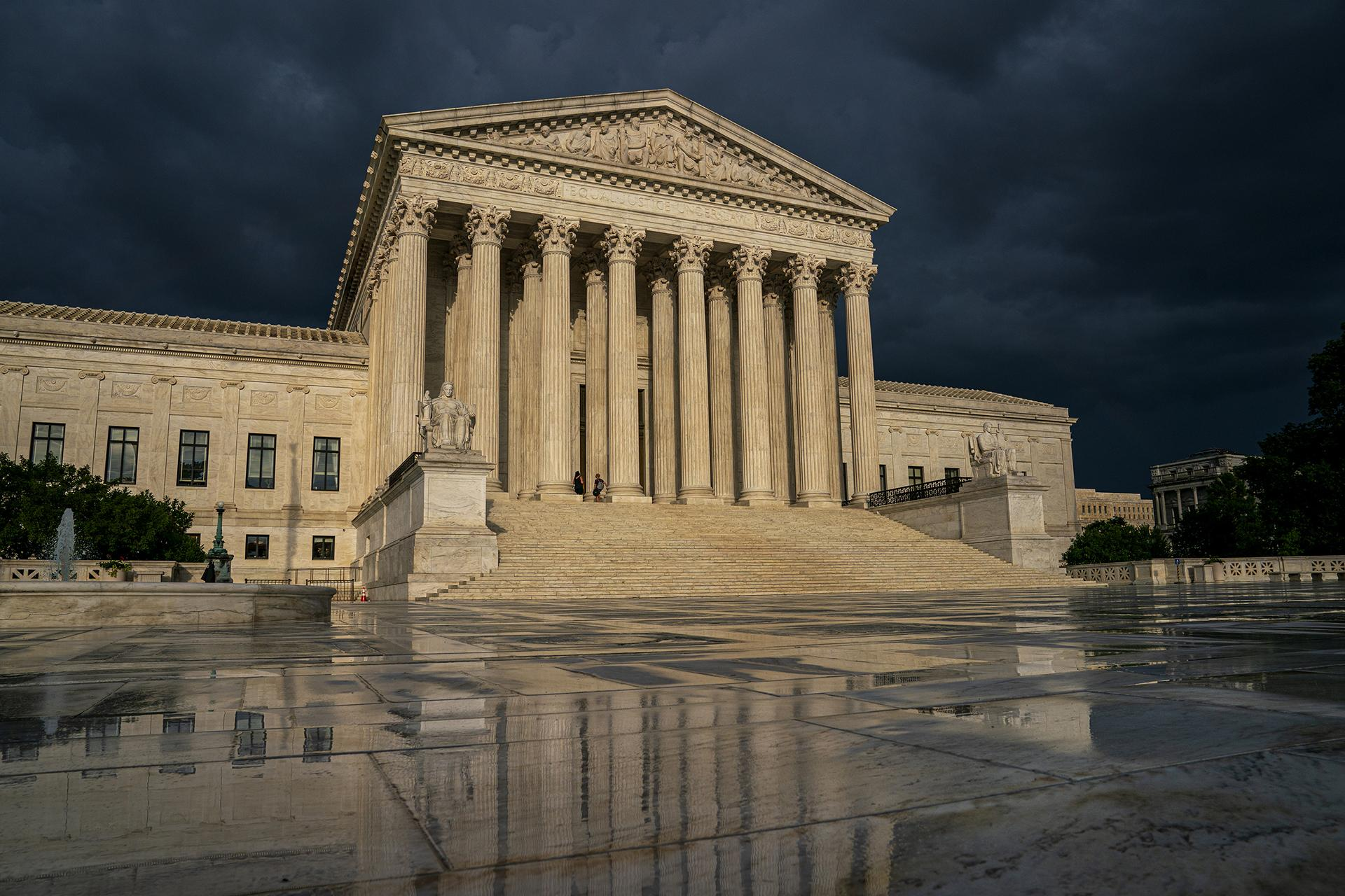 In this June 20, 2019 file photo, the Supreme Court is seen under stormy skies in Washington. (AP Photo / J. Scott Applewhite, File)