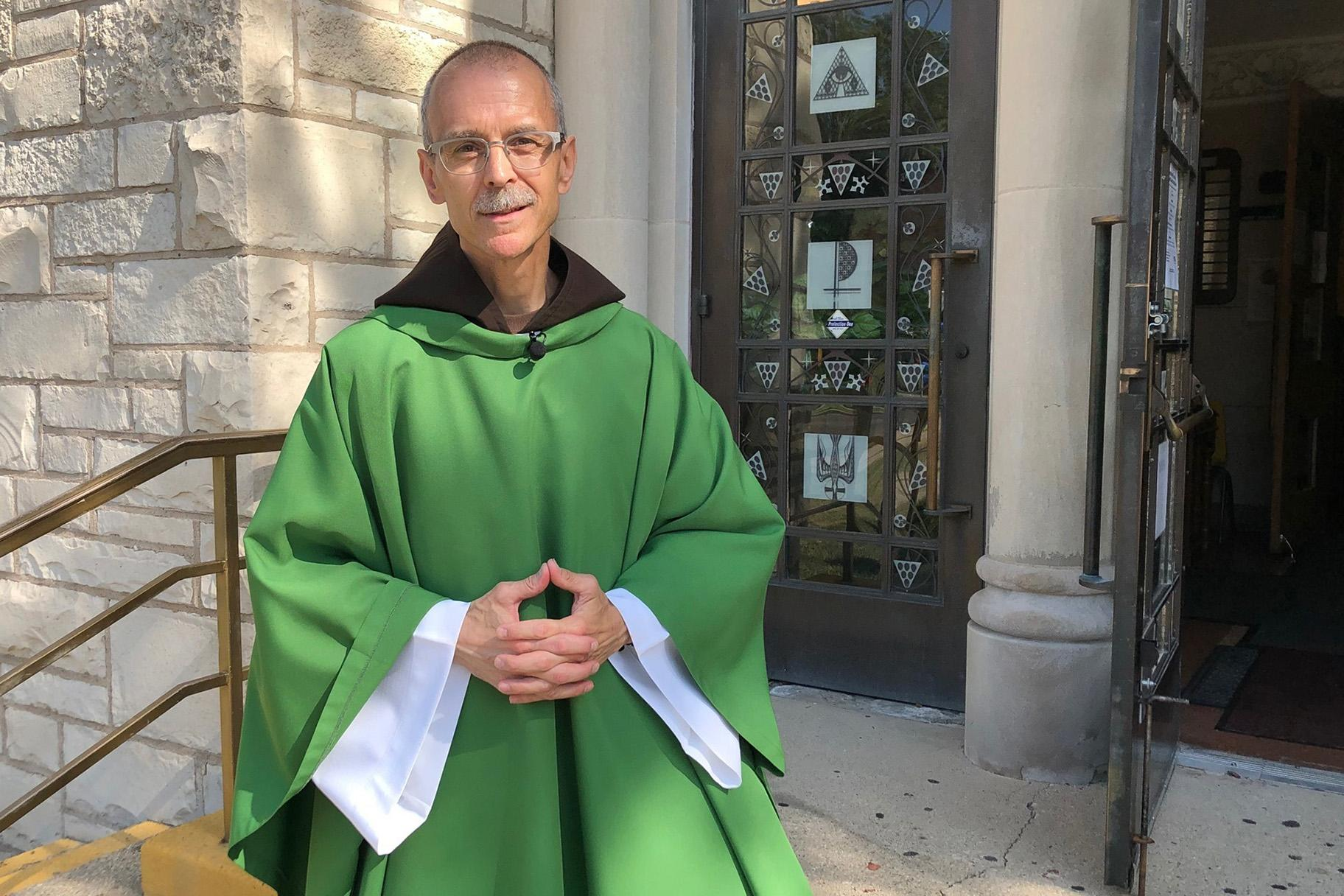 Rev. John Celichowski poses outside of the Saint Clare of Montefalco Catholic Church in Chicago. (AP Photo / Sophia Tareen)