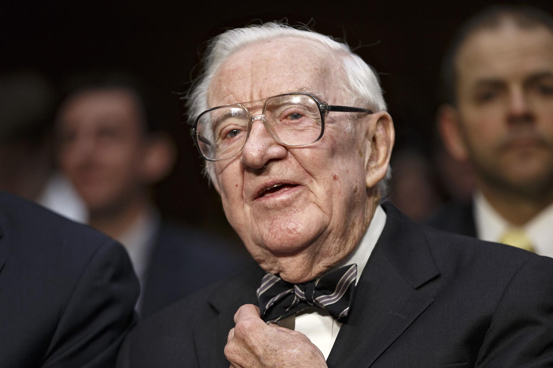 In this April 30, 2014 file photo, retired Supreme Court Justice John Paul Stevens prepares to testify on the ever-increasing amount of money spent on elections as he appears before the Senate Rules Committee on Capitol Hill in Washington. (AP Photo, File)