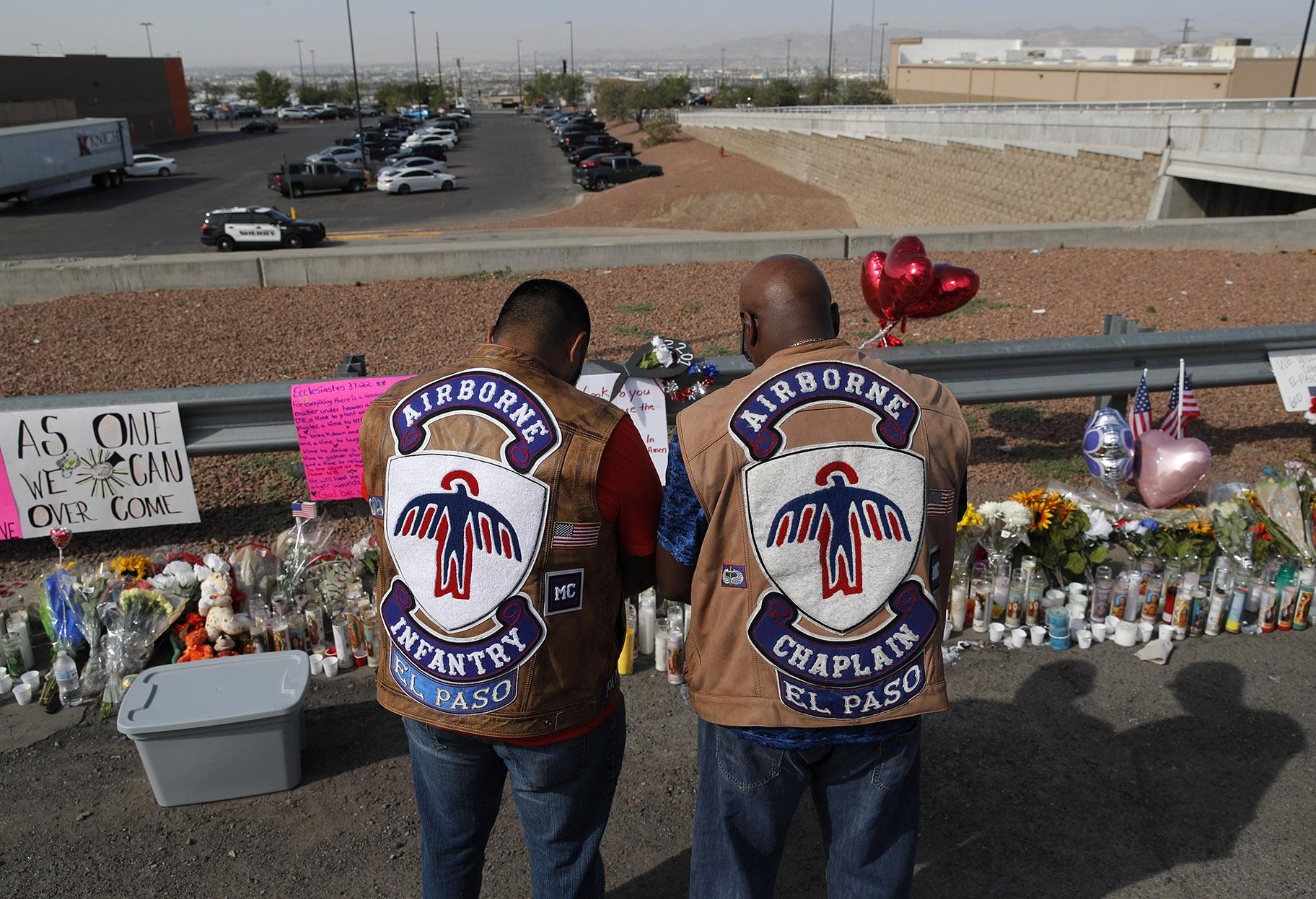 People pray at a makeshift memorial Monday, Aug. 5, 2019 for victims of a mass shooting at a shopping complex in El Paso, Texas. (AP Photo / John Locher)