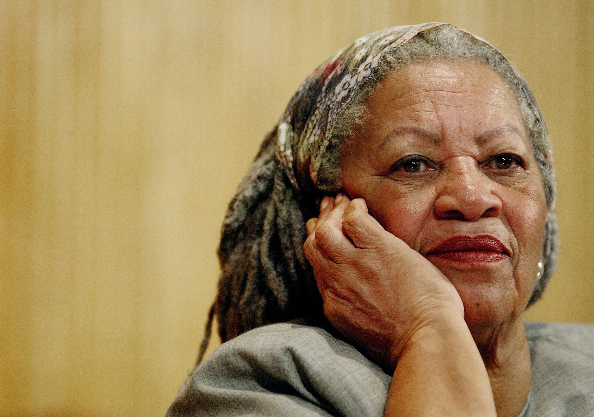 In this Nov. 25, 2005 file photo, author Toni Morrison listens to Mexico's Carlos Monsivais during the Julio Cortazar professorship conference at the Guadalajara's University in Guadalajara City, Mexico.  (AP Photo / Guillermo Arias, File)