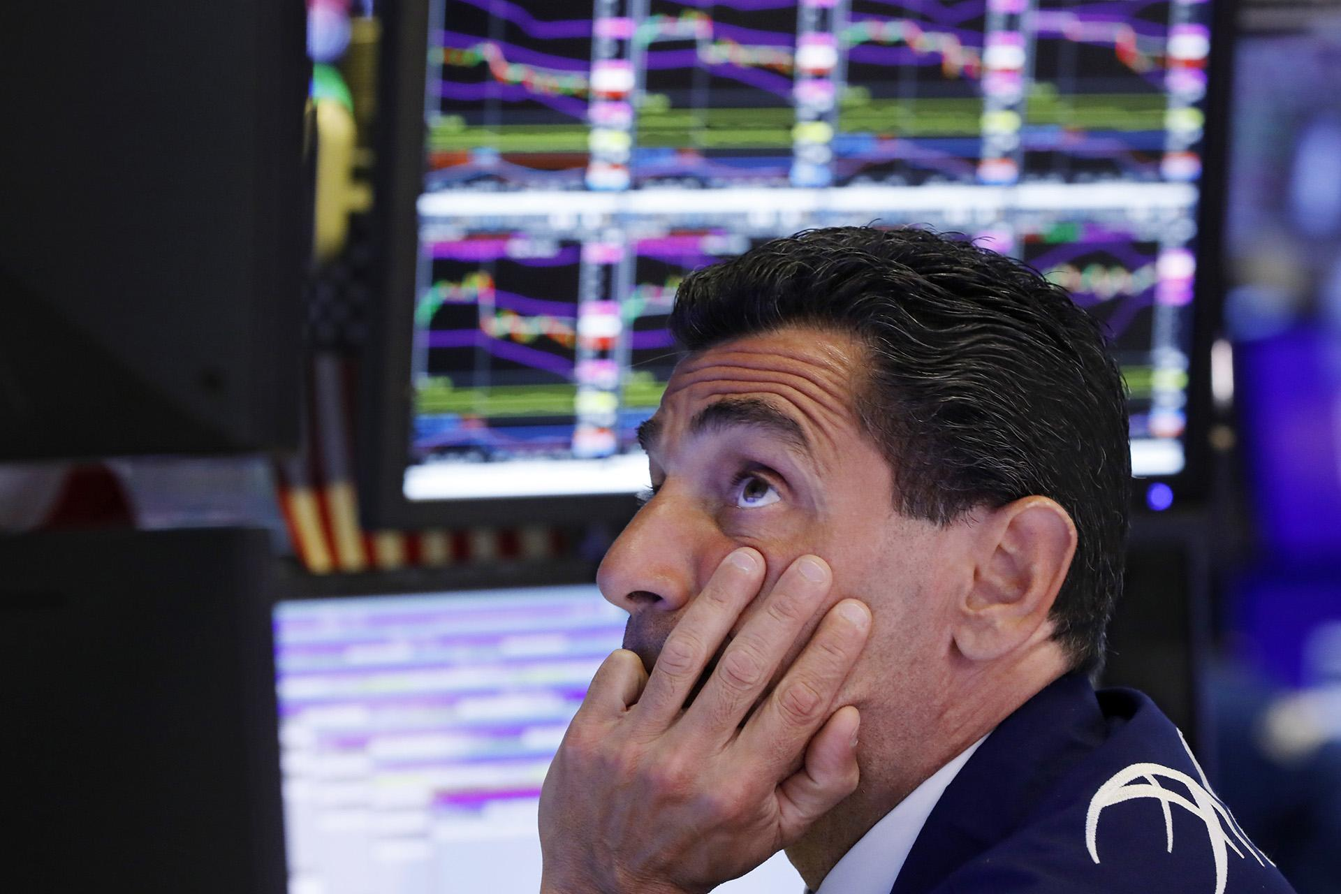 In this Aug. 12, 2019, photo specialist Peter Mazza works at his post on the floor of the New York Stock Exchange. (AP Photo / Richard Drew, File)