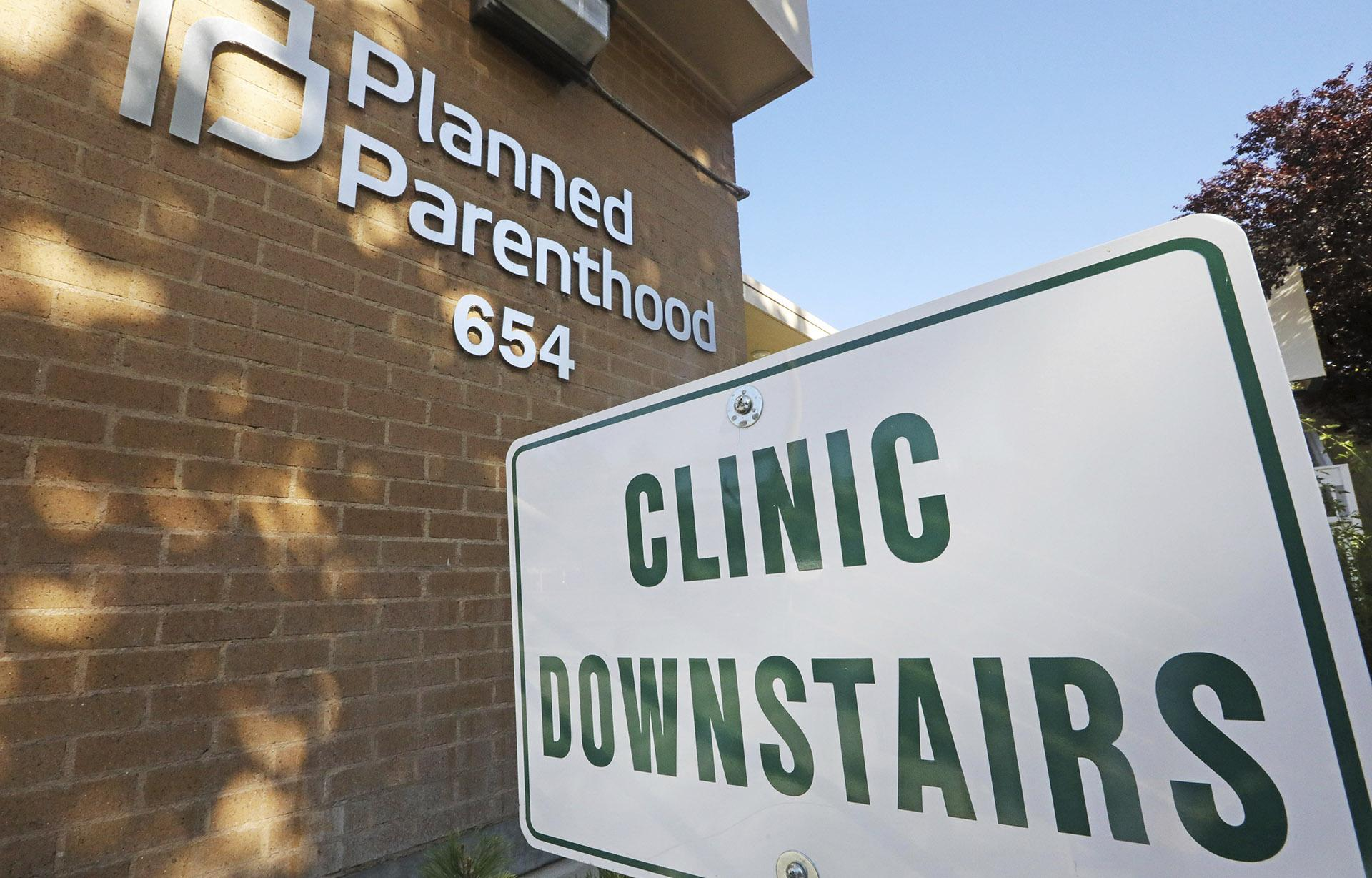 A sign is displayed at Planned Parenthood of Utah Wednesday, Aug. 21, 2019, in Salt Lake City. About 39,000 people received treatment from Planned Parenthood of Utah in 2018 under a federal family planning program called Title X. The organization this week announced it is pulling out of the program rather than abide by a new Trump administration rule prohibiting clinics from referring women for abortions. (AP Photo / Rick Bowmer)
