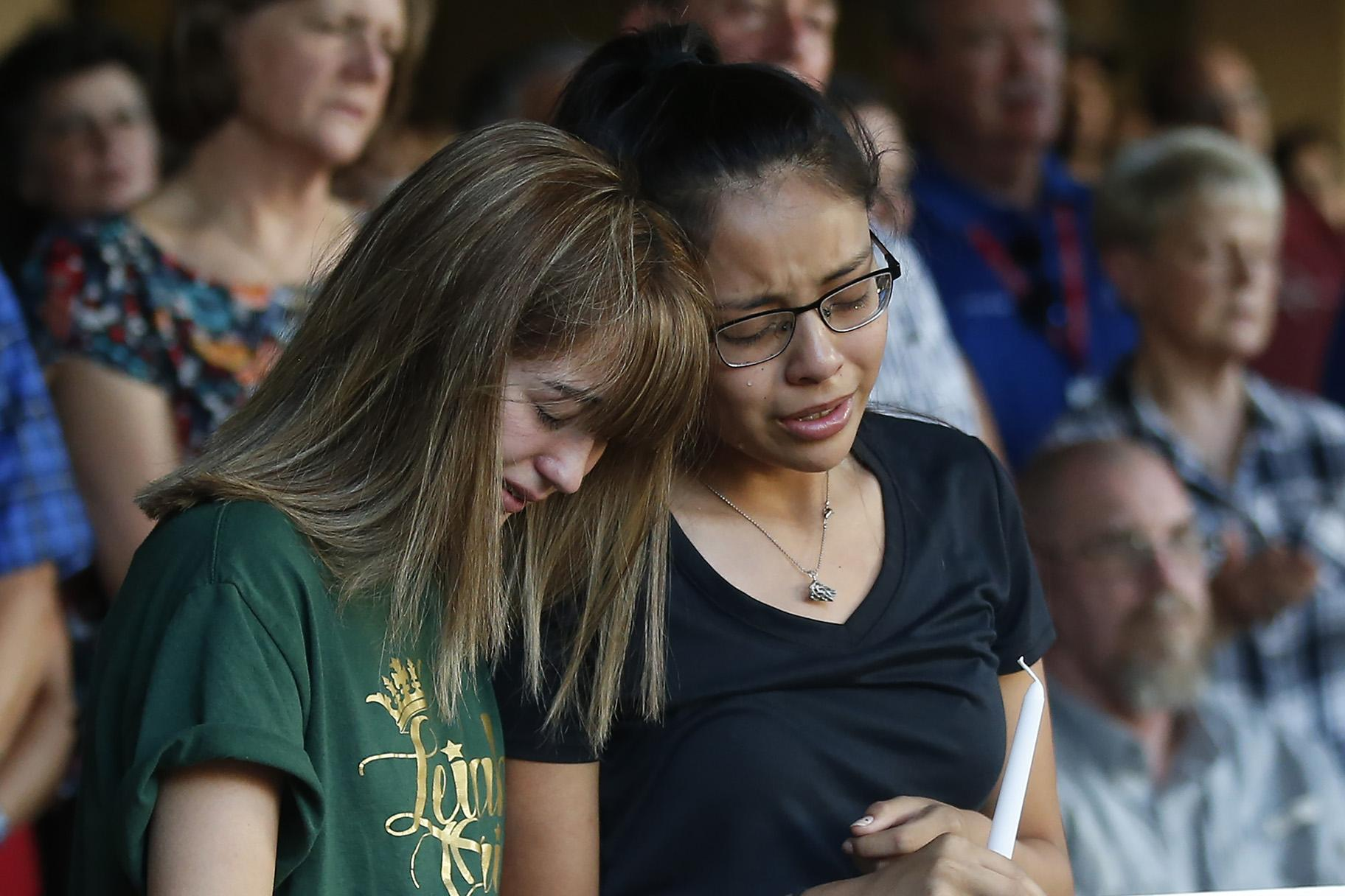 High school students Celeste Lujan, left, and Yasmin Natera mourn their friend Leilah Hernandez, one of the victims of the Saturday shooting in Odessa, at a memorial service Sunday, Sept. 1, 2019, in Odessa, Texas. (AP Photo / Sue Ogrocki)