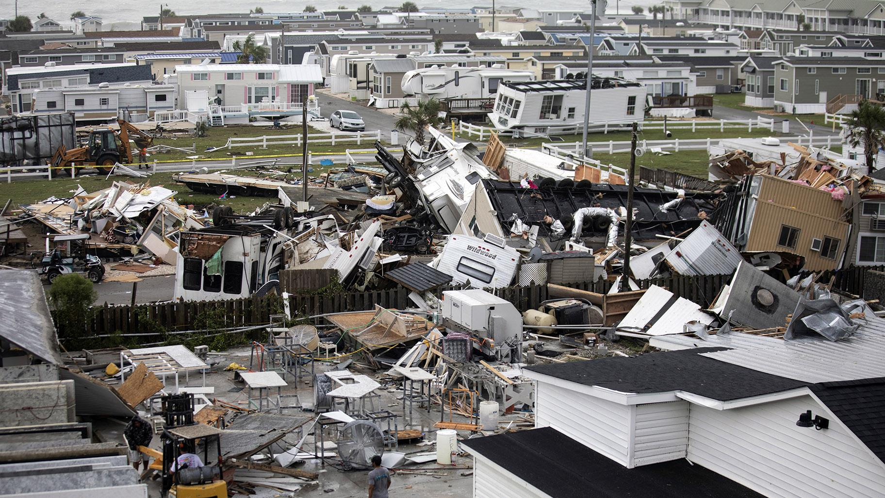 Mobile homes are upended and debris is strewn about at the Holiday Trav-l Park, Thursday, Sept. 5, 2019, in Emerald Isle, N.C, after a possible tornado generated by Hurricane Dorian struck the area. (Julia Wall / The News & Observer via AP)