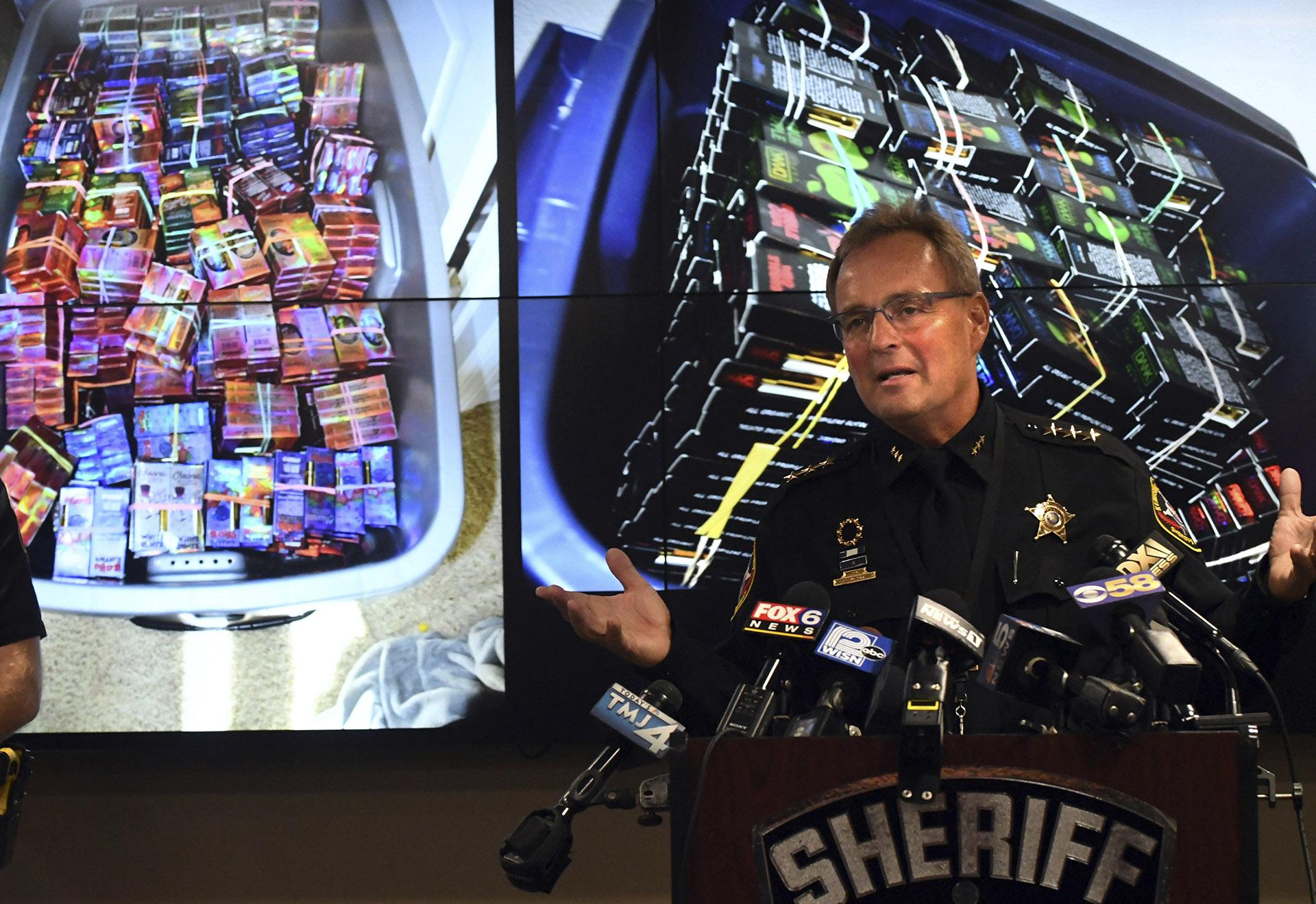 Kenosha County Sheriff David Beth talks about the THC-infused vaping cartridges that were part of a large-scale marijuana operation during a news conference in Kenosha Wednesday, Sept. 11, 2019. (Paul Williams / The Kenosha News via AP)
