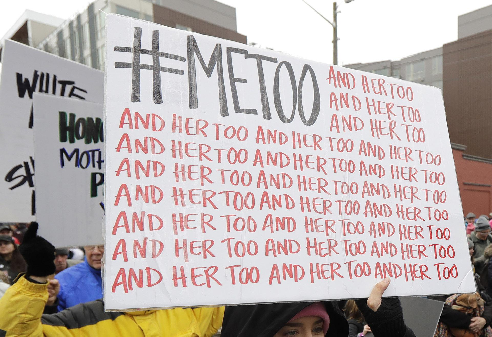In this Jan. 20, 2018 file photo, a marcher carries a sign with the popular Twitter hashtag #MeToo used by people speaking out against sexual harassment as she takes part in a Women's March in Seattle.   (AP Photo / Ted S. Warren, File)