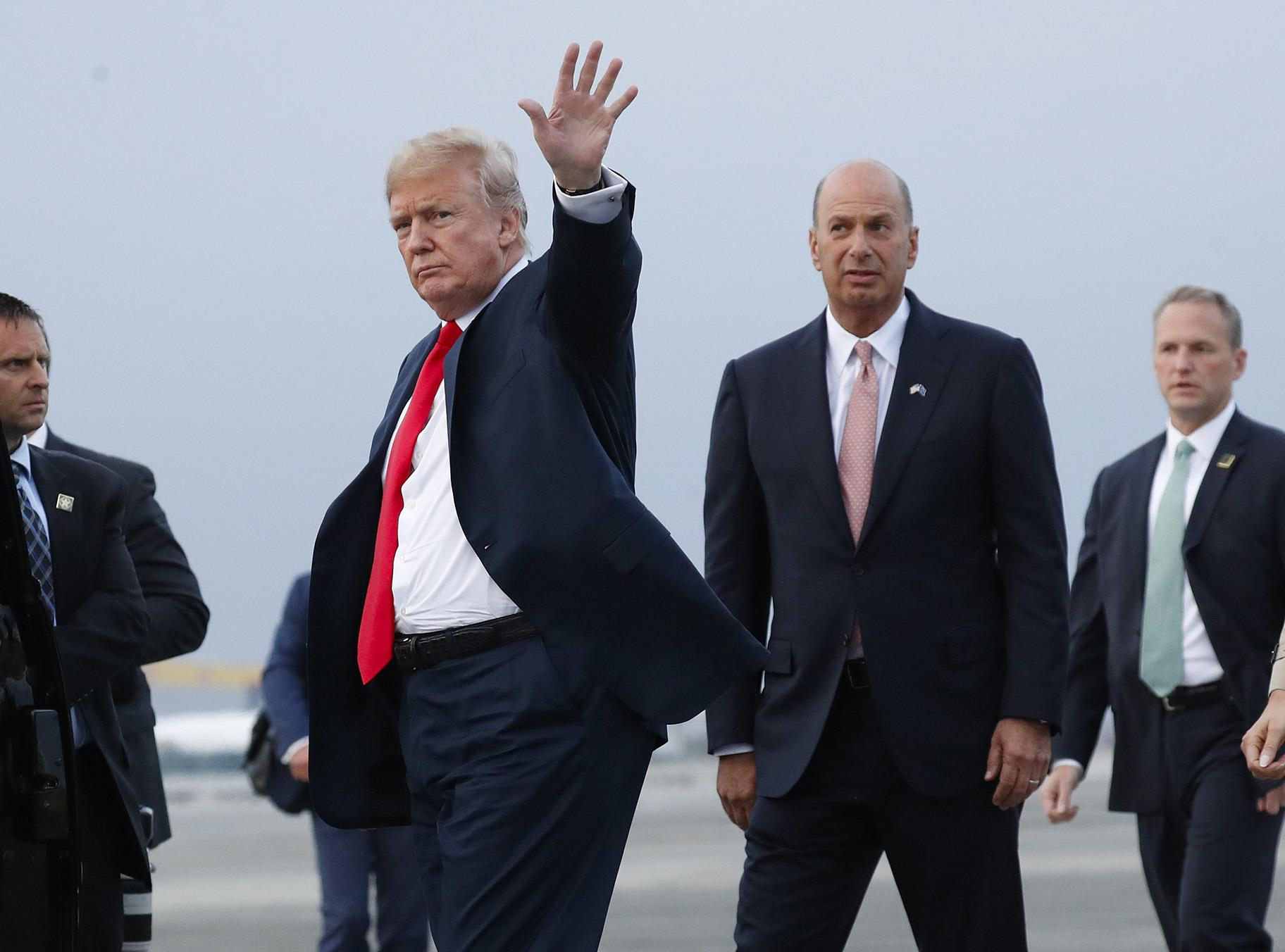In this Tuesday, July 10, 2018, file photo, President Donald Trump is joined by Gordon Sondland, the U.S. ambassador to the European Union, second from right, as he arrives at Melsbroek Air Base, in Brussels, Belgium. (AP Photo / Pablo Martinez Monsivais, File)