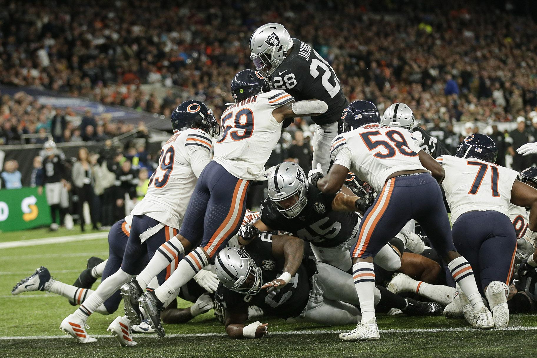 Oakland Raiders running back Josh Jacobs (28) goes in for a touchdown during the second half of an NFL football game against the Chicago Bears at Tottenham Hotspur Stadium, Sunday, Oct. 6, 2019, in London. (AP Photo / Tim Ireland)