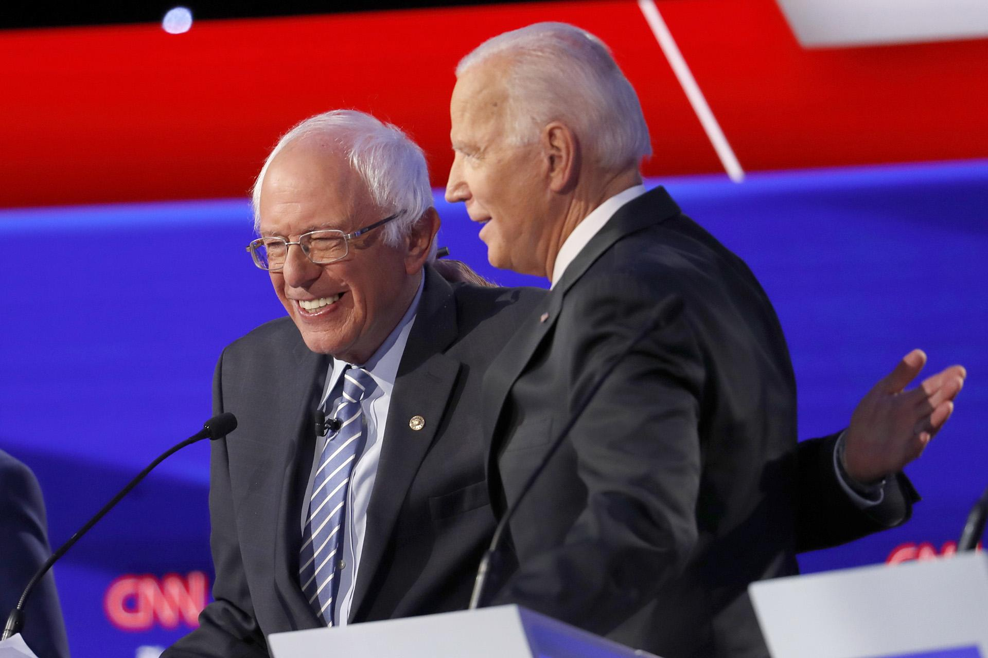 Democratic presidential candidate Sen. Bernie Sanders, I-Vt., left, and former Vice President Joe Biden hug during a Democratic presidential primary debate hosted by CNN/New York Times at Otterbein University, Tuesday, Oct. 15, 2019, in Westerville, Ohio. (AP Photo / John Minchillo)