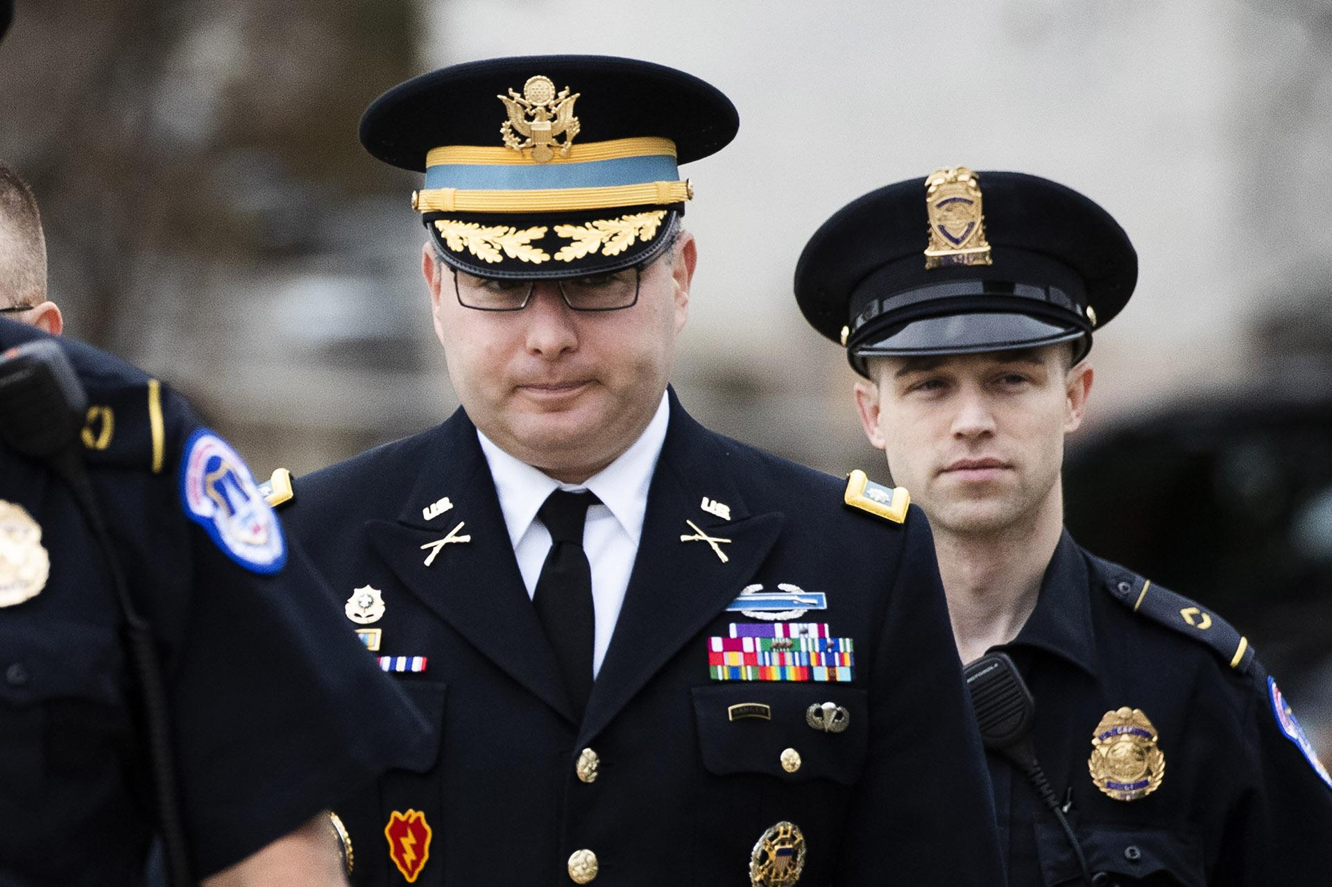 Army Lieutenant Colonel Alexander Vindman, a military officer at the National Security Council, center, arrives on Capitol Hill in Washington, Tuesday, Oct. 29, 2019, to appear before a House Committee on Foreign Affairs, Permanent Select Committee on Intelligence, and Committee on Oversight and Reform joint interview with the transcript to be part of the impeachment inquiry into President Donald Trump. (AP Photo / Manuel Balce Ceneta)