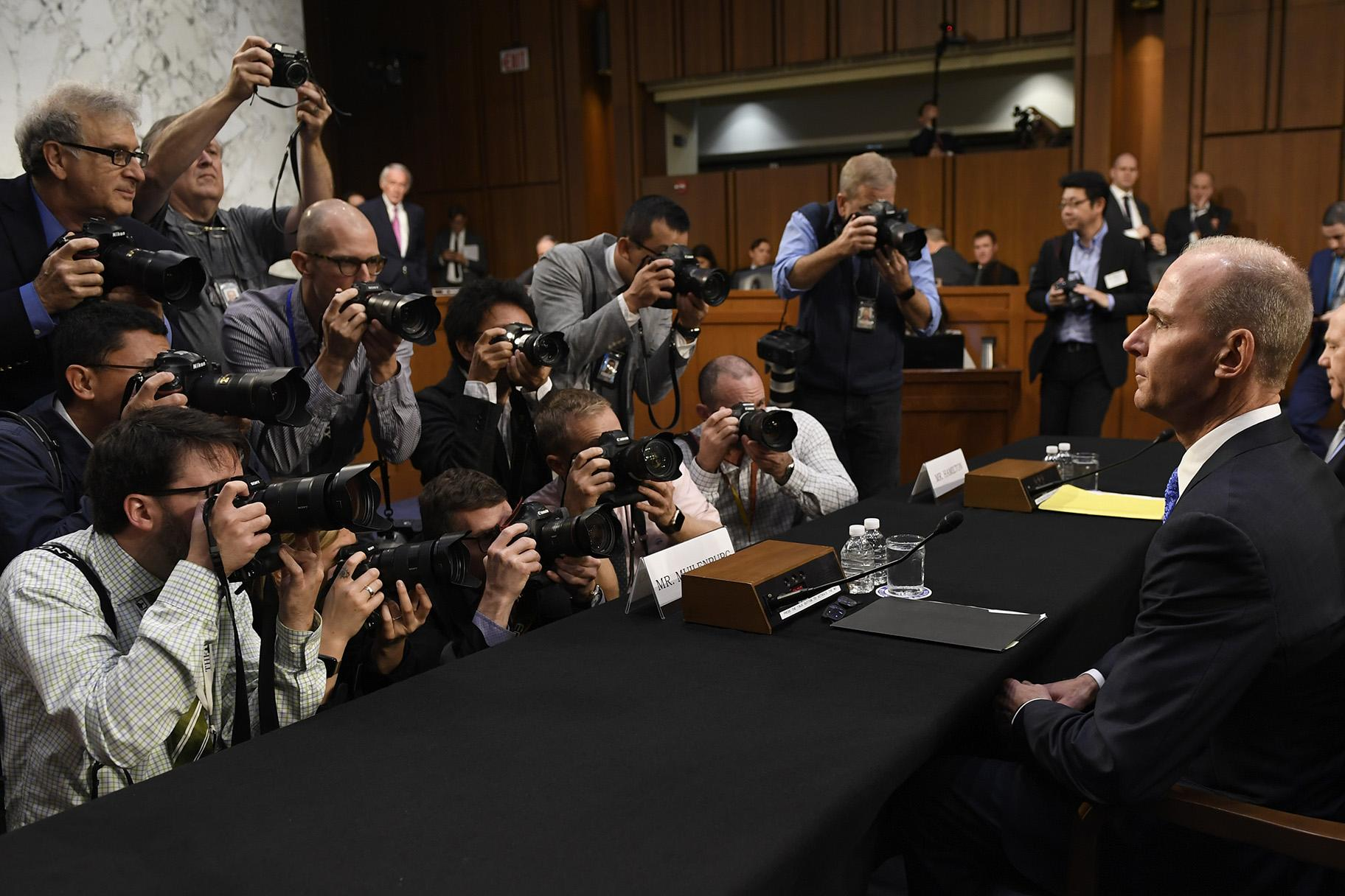"Boeing Company President and CEO Dennis Muilenburg, right, is surrounded by photographers on Capitol Hill in Washington, Tuesday, Oct. 29, 2019, before the start of a Senate Committee on Commerce, Science, and Transportation hearing on ""Aviation Safety and the Future of Boeing's 737 MAX."" (AP Photo / Susan Walsh)"