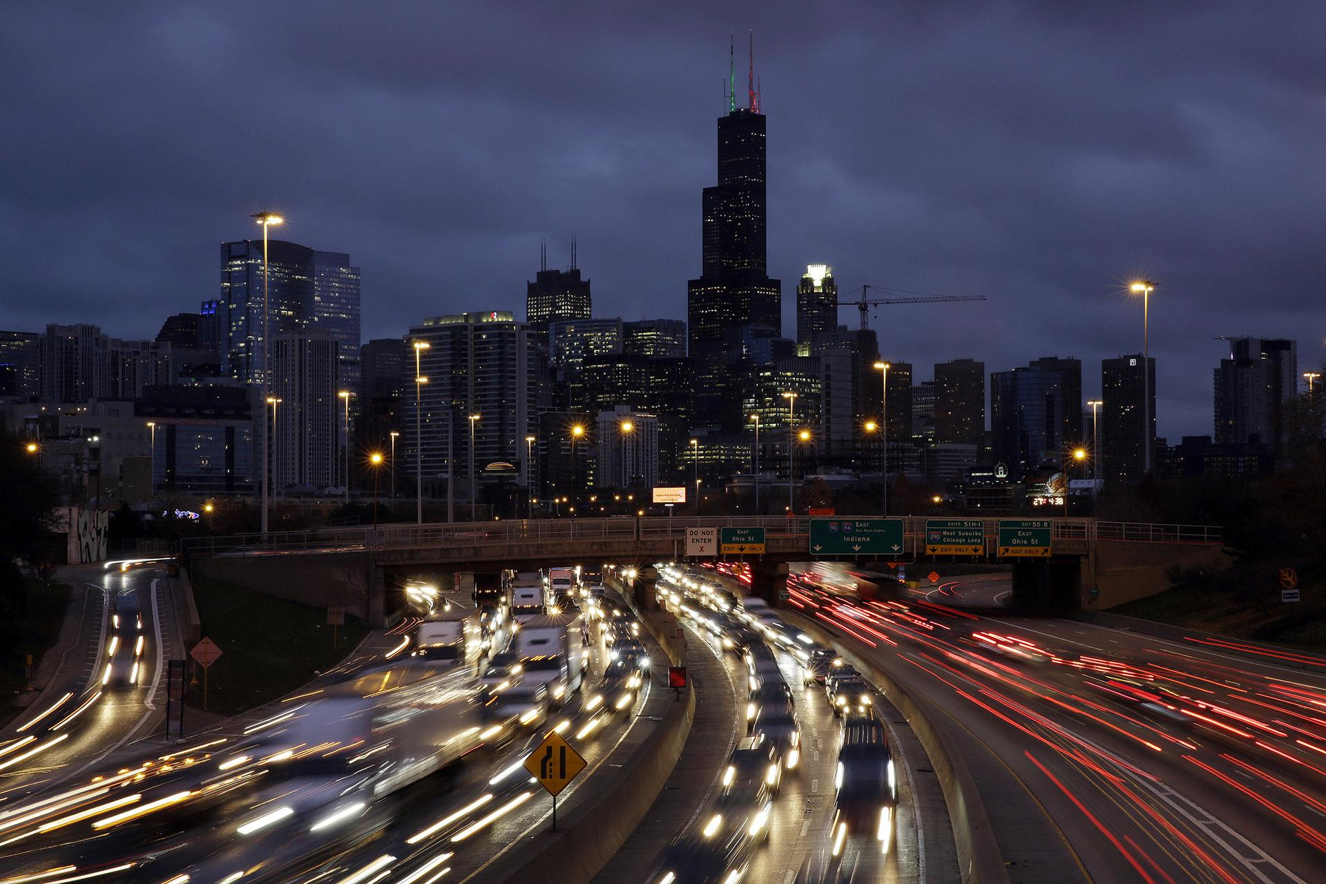 In this Nov. 21, 2018, file photo taken with a long exposure, traffic streaks across the John F. Kennedy Expressway at the start of the Thanksgiving holiday weekend in Chicago. (AP Photo / Kiichiro Sato, File)