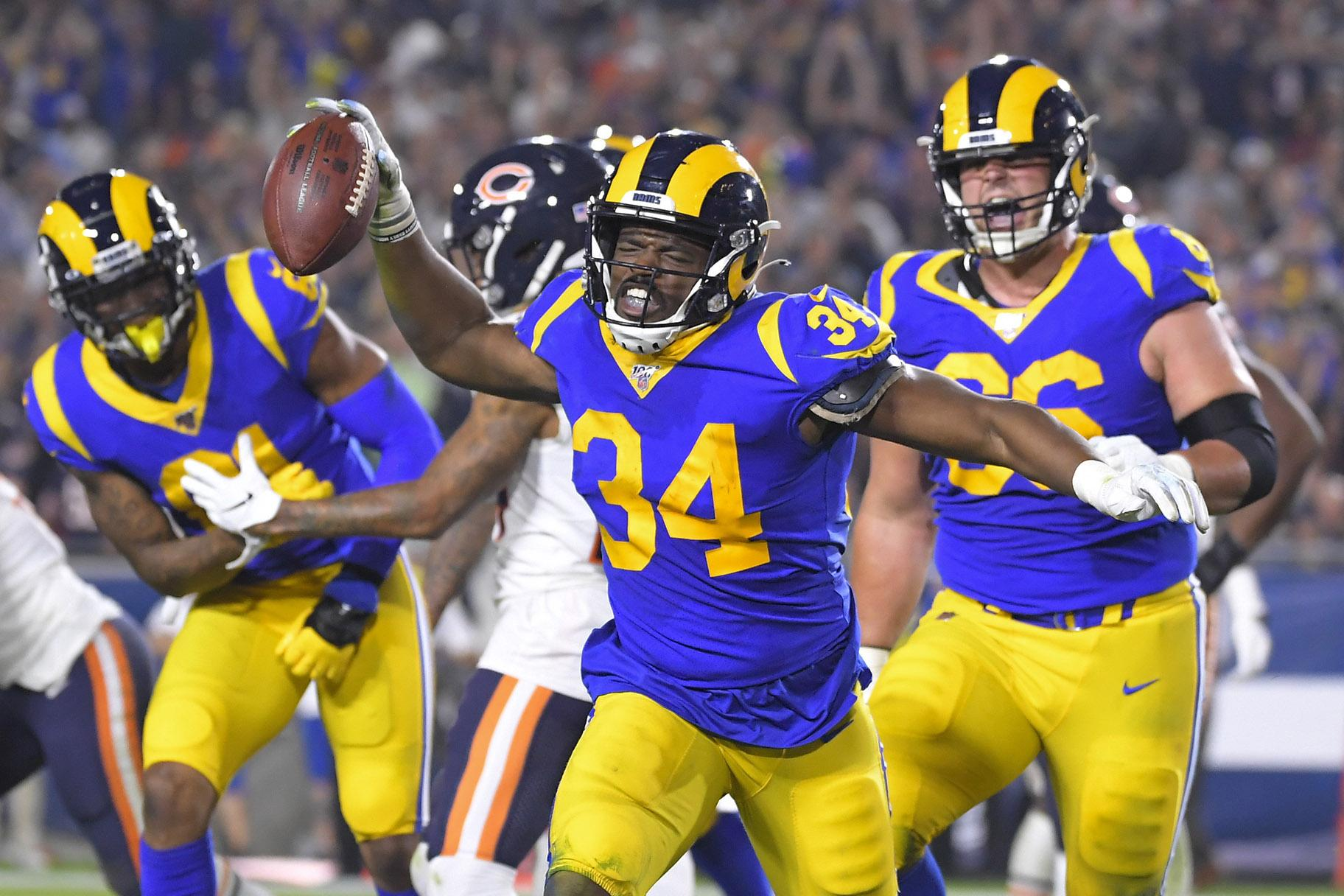 Los Angeles Rams running back Malcolm Brown celebrates after scoring against the Chicago Bears during the second half of an NFL football game Sunday, Nov. 17, 2019, in Los Angeles. (AP Photo / Mark J. Terrill)