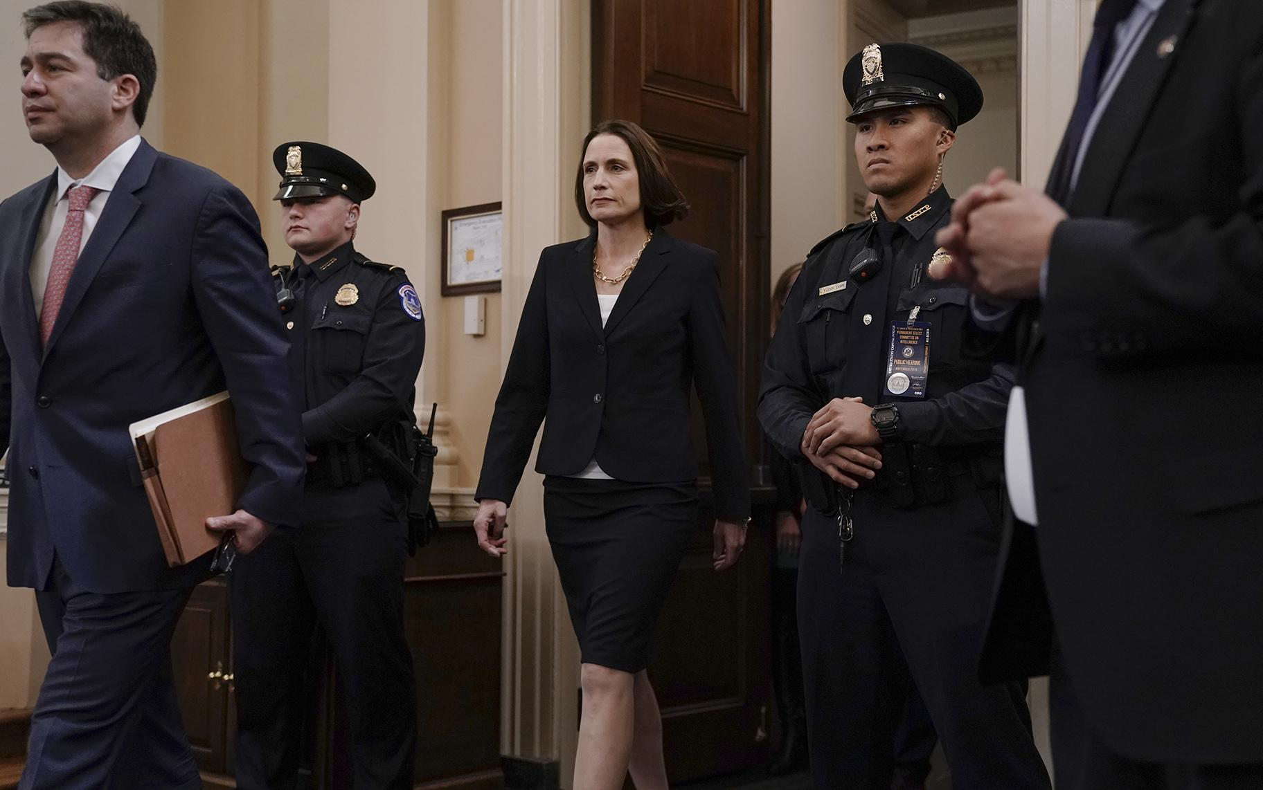 Former White House national security aide Fiona Hill returns from a break to testify before the House Intelligence Committee on Capitol Hill in Washington, Thursday, Nov. 21, 2019. (AP Photo / J. Scott Applewhite)