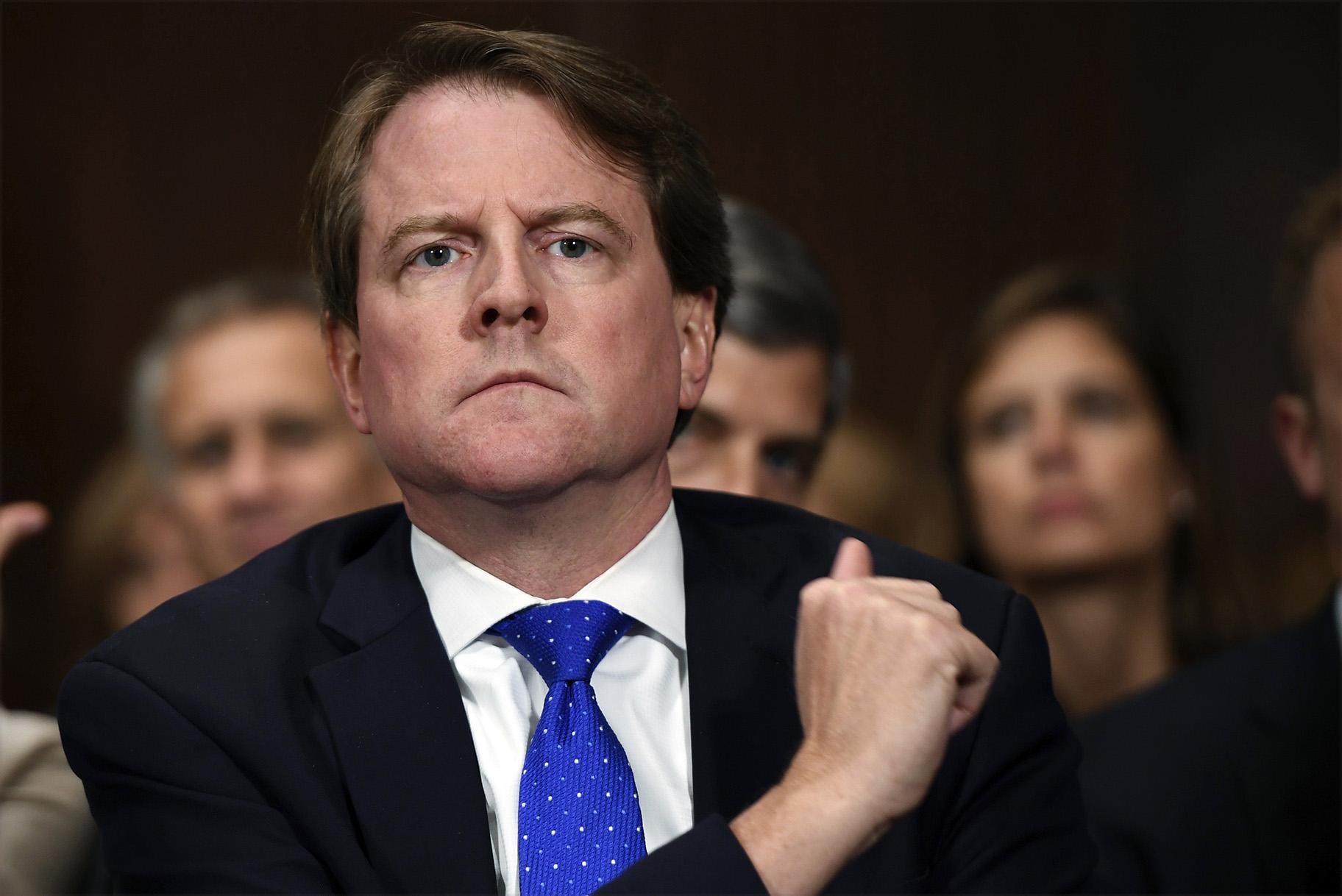 In this Sept. 27, 2018, file photo, then-White House counsel Don McGahn listens as Supreme Court nominee Brett Kavanaugh testifies before the Senate Judiciary Committee on Capitol Hill in Washington. (Saul Loeb / Pool Photo via AP, File)