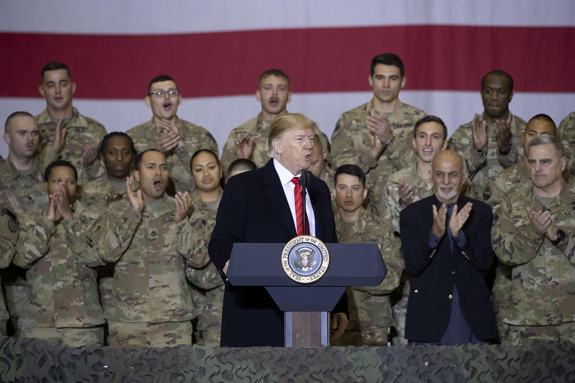 President Donald Trump, center, with Afghan President Ashraf Ghani, second from the right, and Joint Chiefs Chairman Gen. Mark Milley, right, while addressing members of the military during a surprise Thanksgiving Day visit, Thursday, Nov. 28, 2019, at Bagram Air Field, Afghanistan. (AP Photo / Alex Brandon)