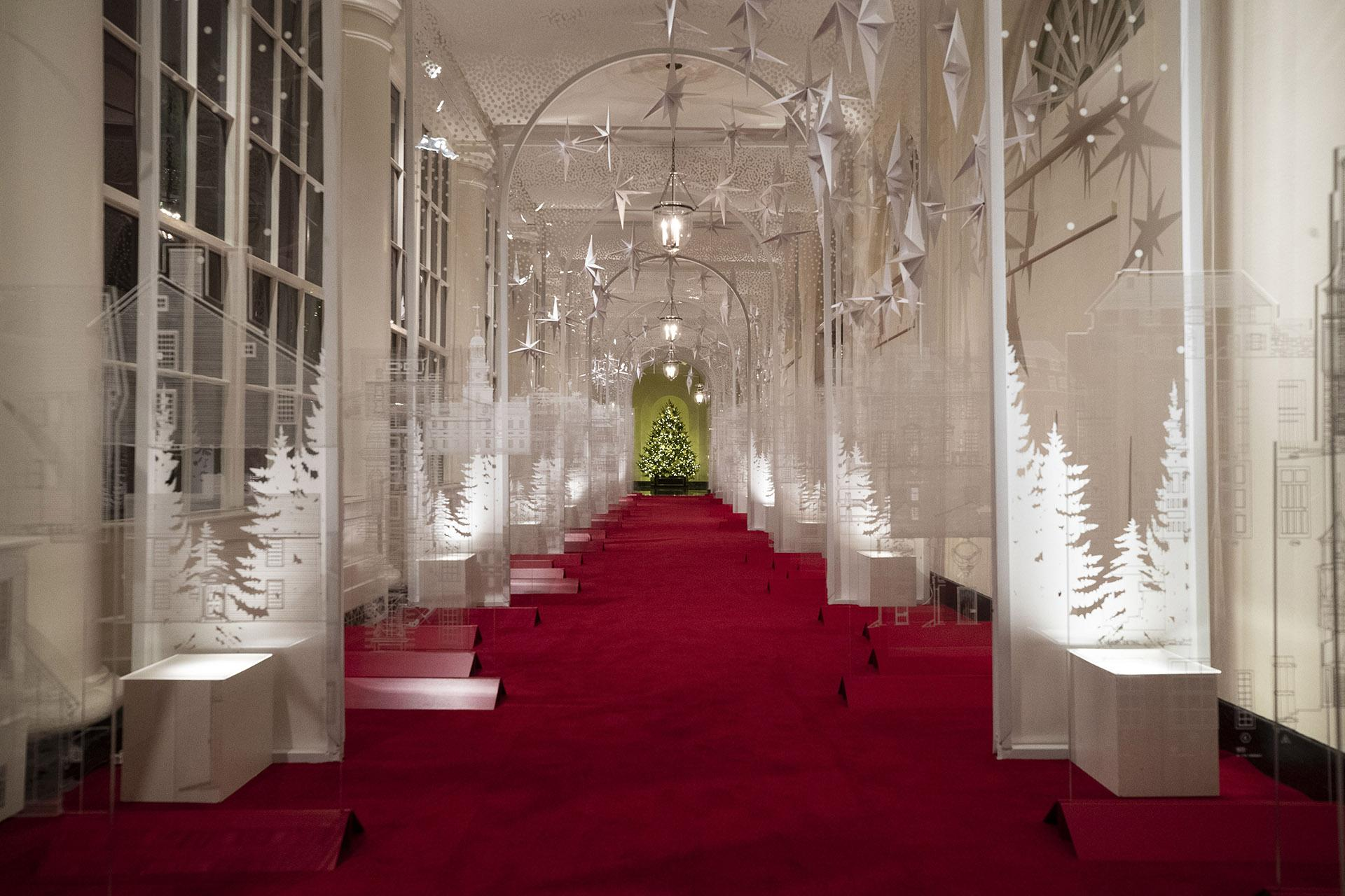 "The East Colonnade is decorated with a timeline of American design, innovation and architecture during the 2019 Christmas preview at the White House, Monday, Dec. 2, 2019, in Washington. This year's theme is, ""The Spirit of America."" (AP Photo / Alex Brandon)"
