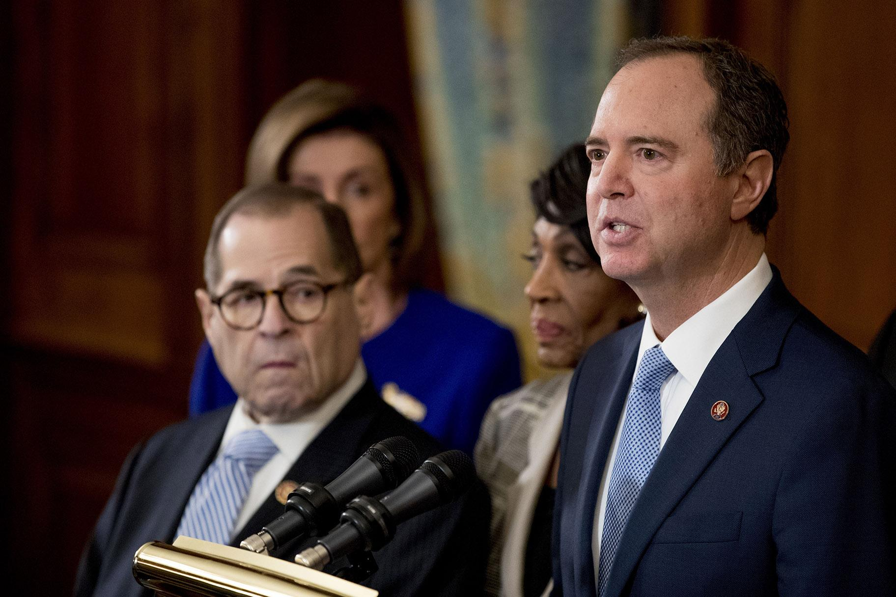 Rep. Adam Schiff, D-Calif., Chairman of the House Intelligence Committee, right, speaks with, from left, Chairman of the House Judiciary Committee Jerrold Nadler, D-N.Y., House Speaker Nancy Pelosi and Chairwoman of the House Financial Services Committee Maxine Waters, D-Calif., second from right, during a news conference to unveil articles of impeachment against President Donald Trump, abuse of power and obstruction of Congress, Tuesday, Dec. 10, 2019, in Washington. (AP Photo / Andrew Harnik)