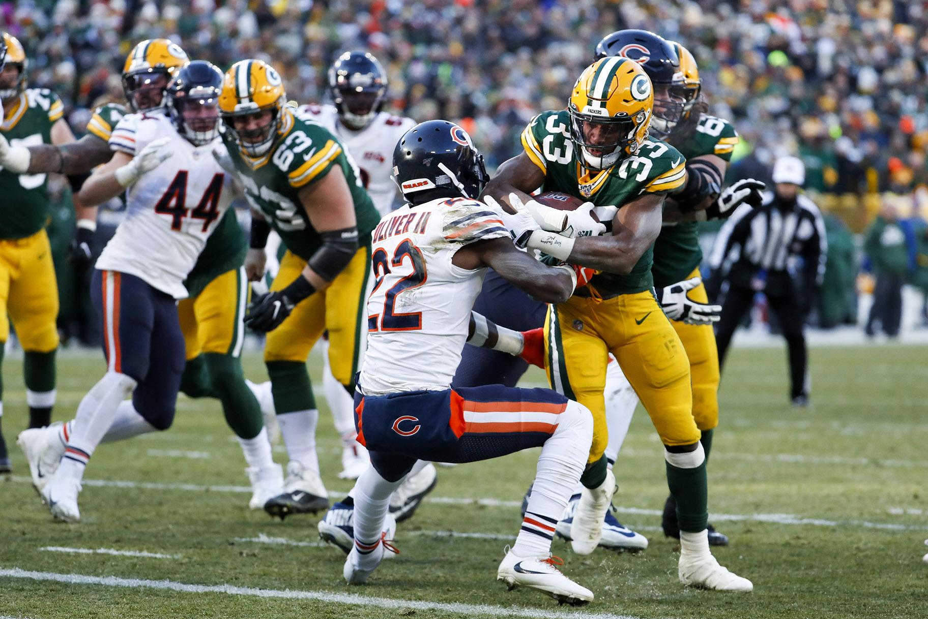 Green Bay Packers' Aaron Jones runs for a touchdown during the second half of an NFL football game against the Chicago Bears Sunday, Dec. 15, 2019, in Green Bay, Wis. (AP Photo / Matt Ludtke