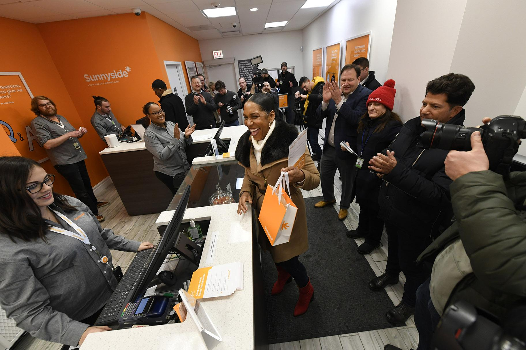 Illinois Lt. Gov. Juliana Stratton reacts after purchasing recreational marijuana at Sunnyside dispensary Wednesday, Jan. 1, 2020, in Chicago. (AP Photo / Paul Beaty)