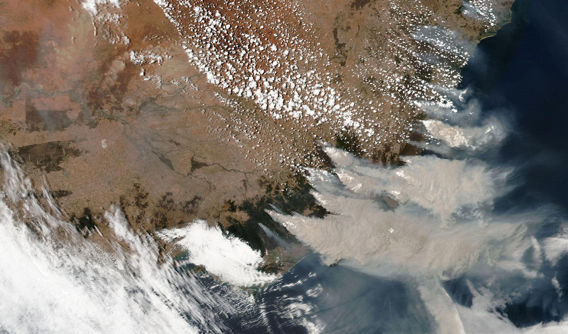 This satellite image provided by NASA on Saturday, Jan. 4, 2020 shows wildfires in Victoria and New South Wales, Australia. (NASA via AP)