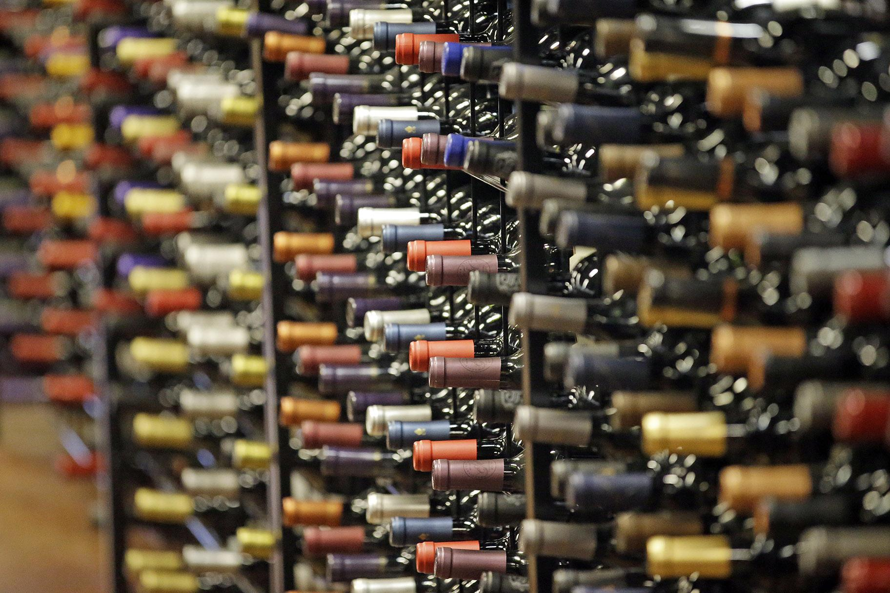 In this June 16, 2016, file photo, bottles of wine are displayed during a tour of a state liquor store, in Salt Lake City. According to federal health statistics, Americans are drinking more now than when Prohibition was enacted a century earlier. (AP Photo / Rick Bowmer, File)