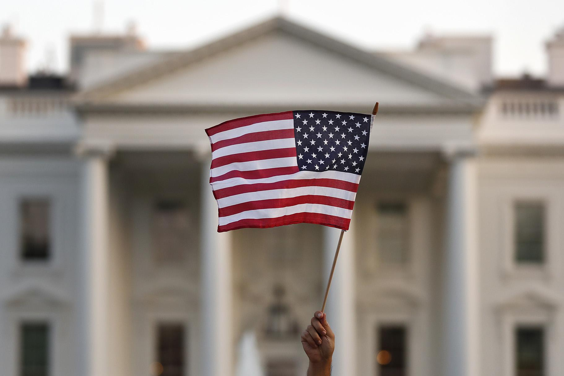 In this Sept. 2017 file photo, a flag is waved outside the White House, in Washington. (AP Photo / Carolyn Kaster)